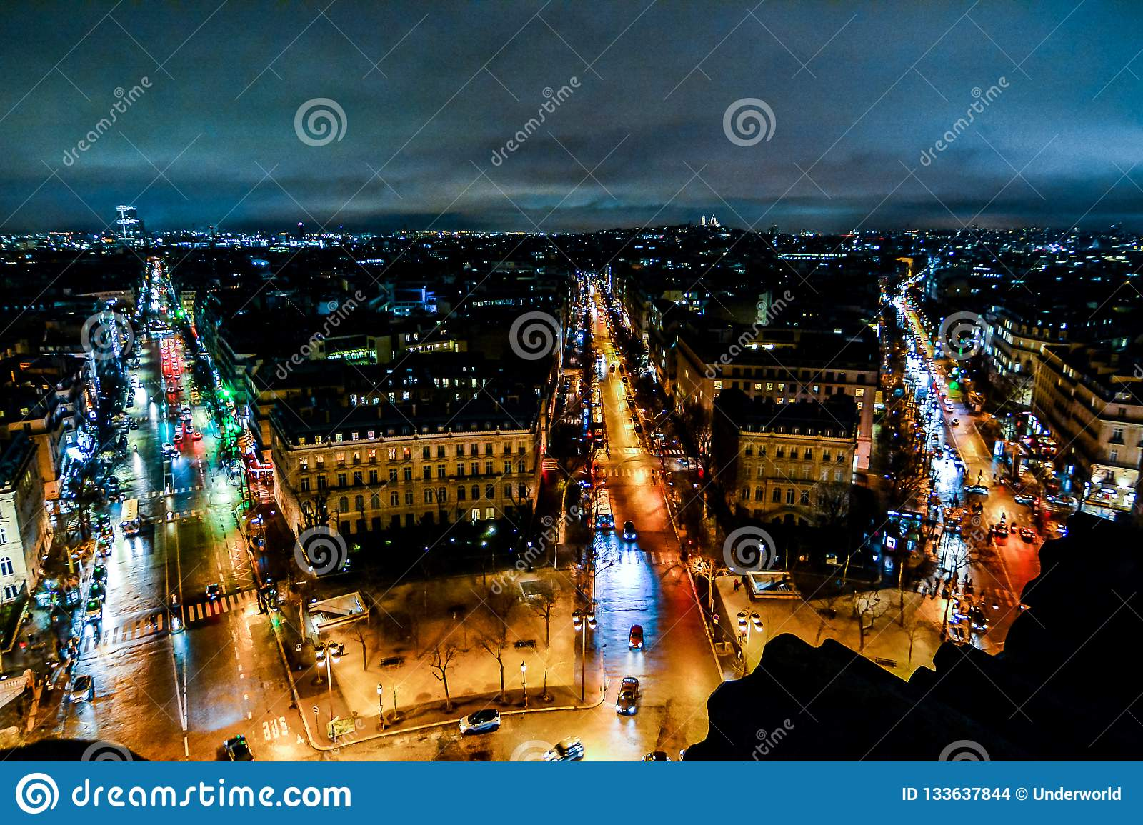 view from Arc de triomphe at night,Photo image a Beautiful panoramic view of Paris Metropolitan City