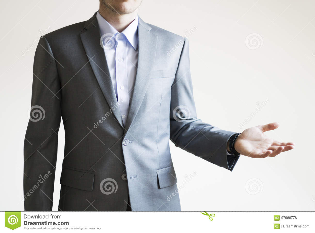 Photo of a man in grey suit with presenting something on white b
