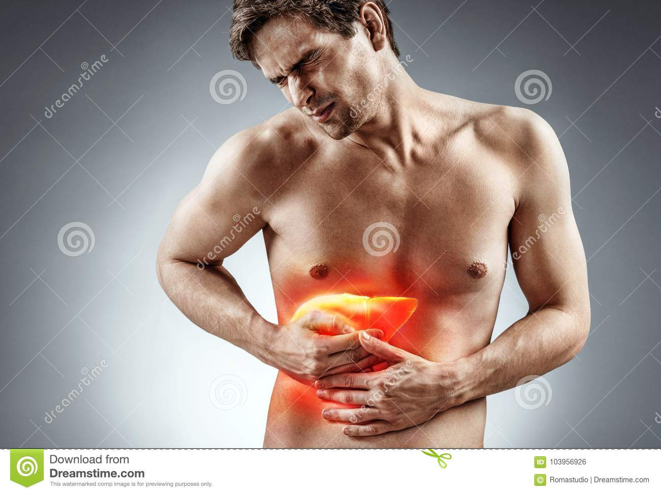 Photo of man holding his hand in area liver