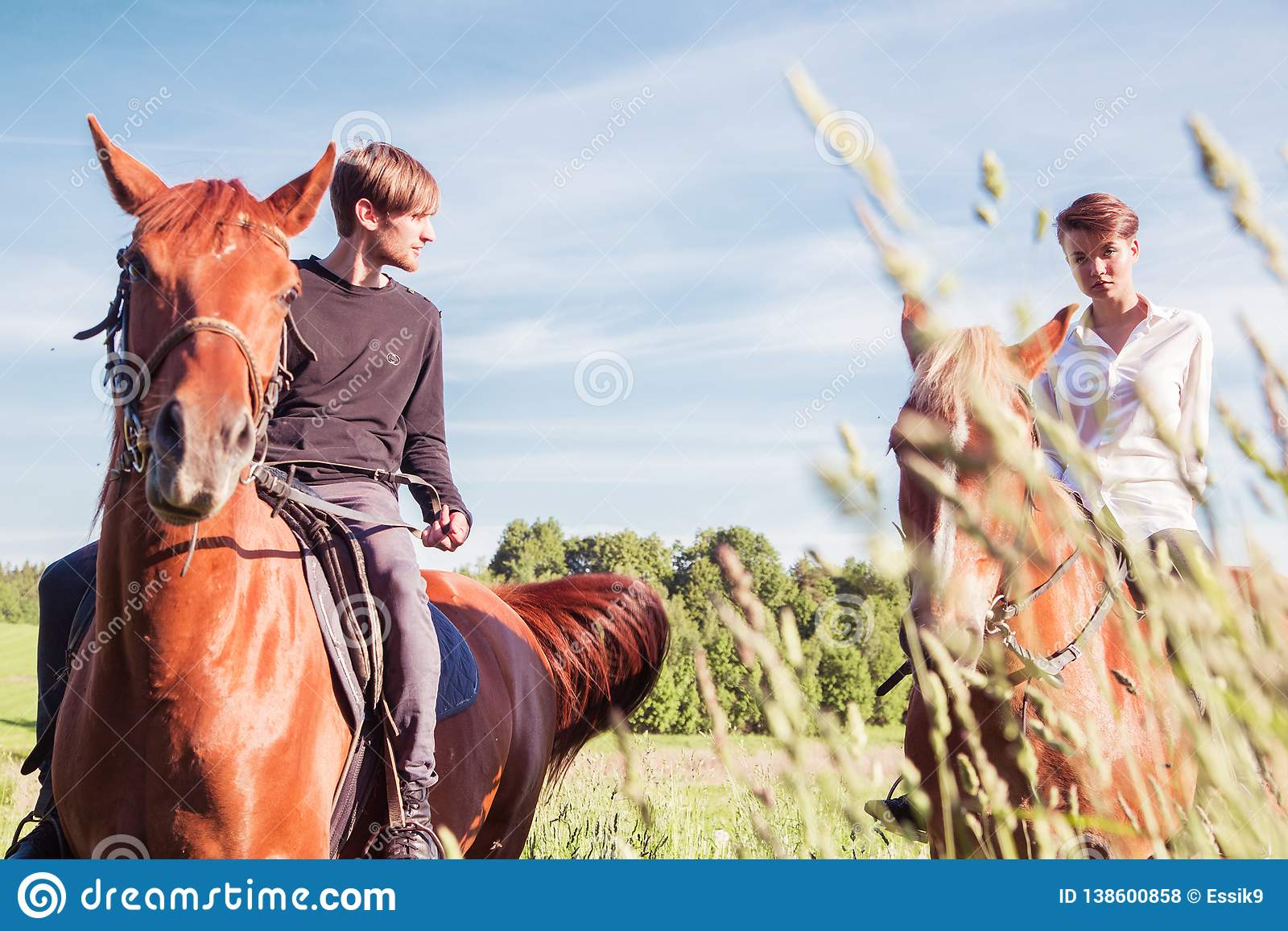 Man And Woman On Horseback Ride Together Stock Photo Image Of Equestrian Male 138600858