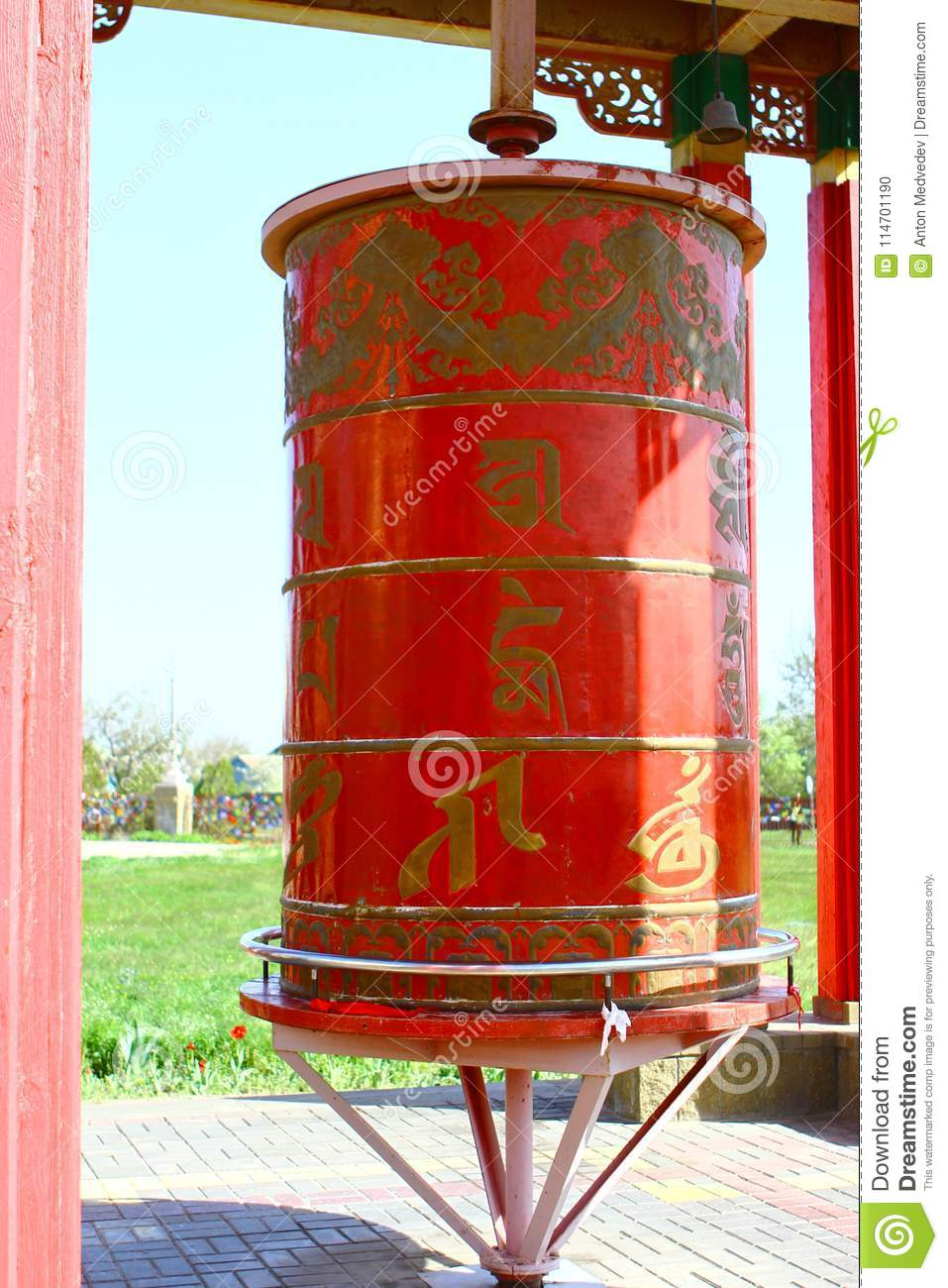 Photo Of The Red Prayer Drums In A Buddhist Temple At Day