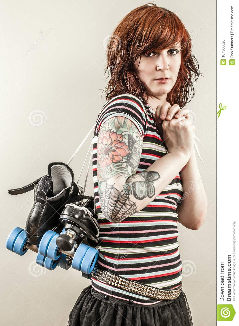 Beautiful roller derby woman holding skates