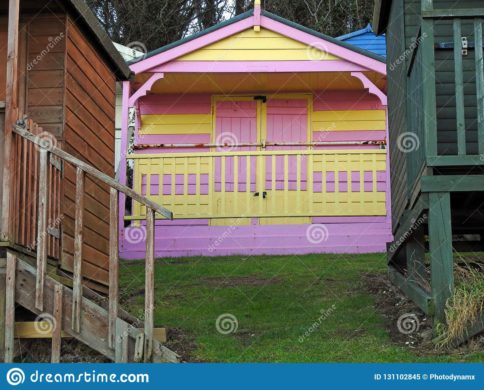 Beach Huts Chalets Sheds In A Row By The Coast Stock Image - Image
