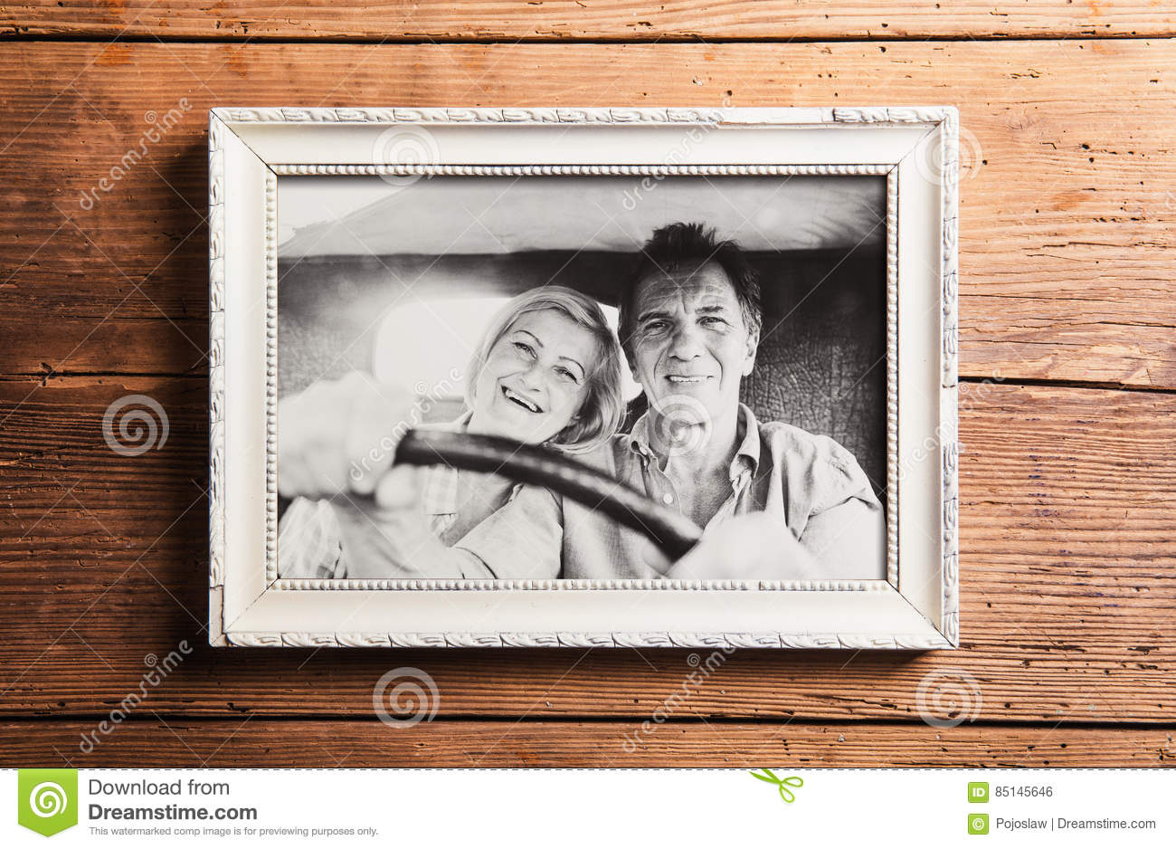 Photo Of Seniors In Picture Frame Laid On Wooden Background. Stock ...