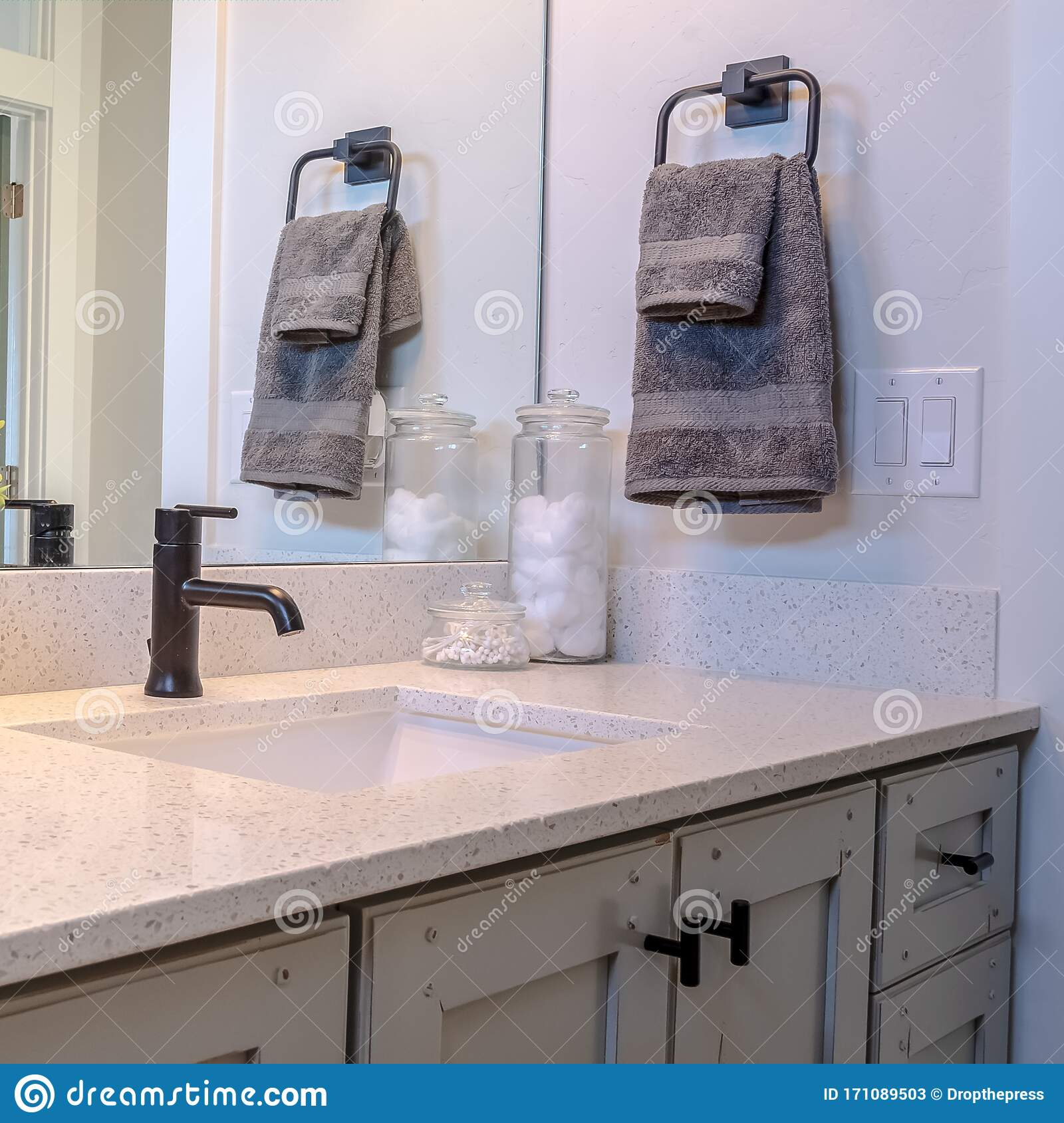 Photo Square Frame Bathroom Vanity Cabinet With Sink Black Faucet Ornamental Plant And Mirror Stock Image Image Of Faucet Drawers 171089503
