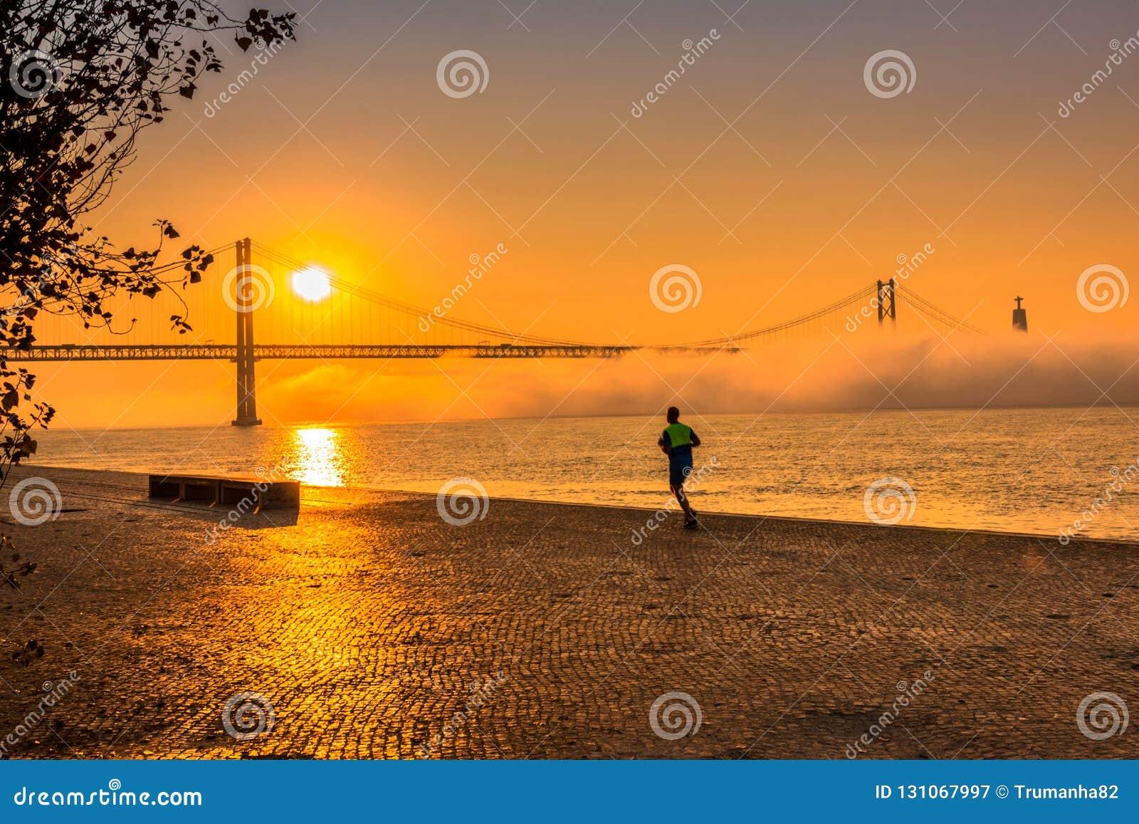 A Man Running at Gorgeous Orange Sunrise