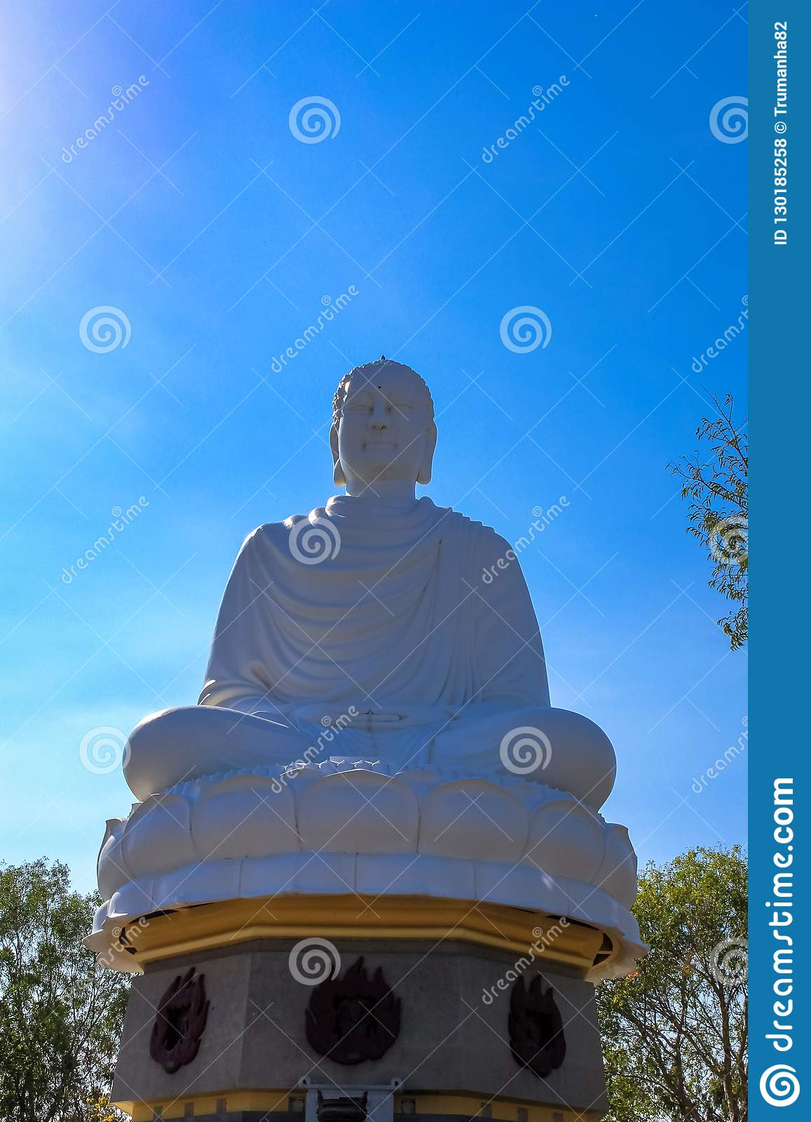 A Huge White Sitting Budha Statue against Blue Sky