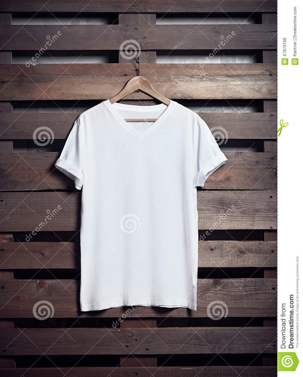 photo of white tshirt hanging on wood background vertical