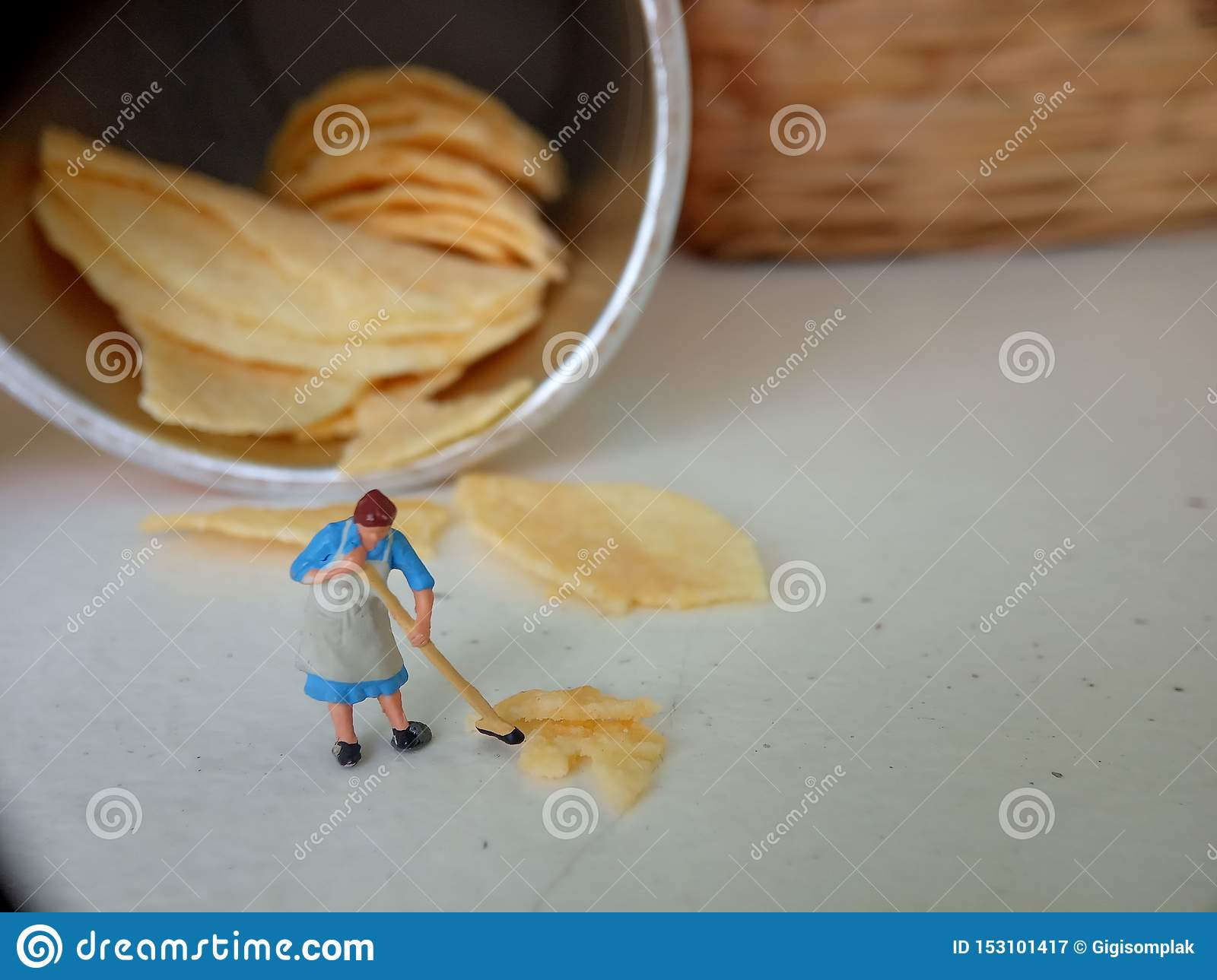 Conceptual, Photo 1 woman cleaning spill of cheese potato chips