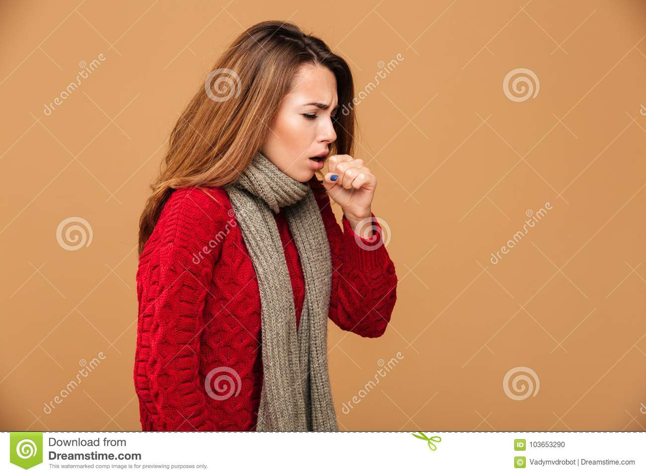 Photo of young coughing brunette woman in warm wear