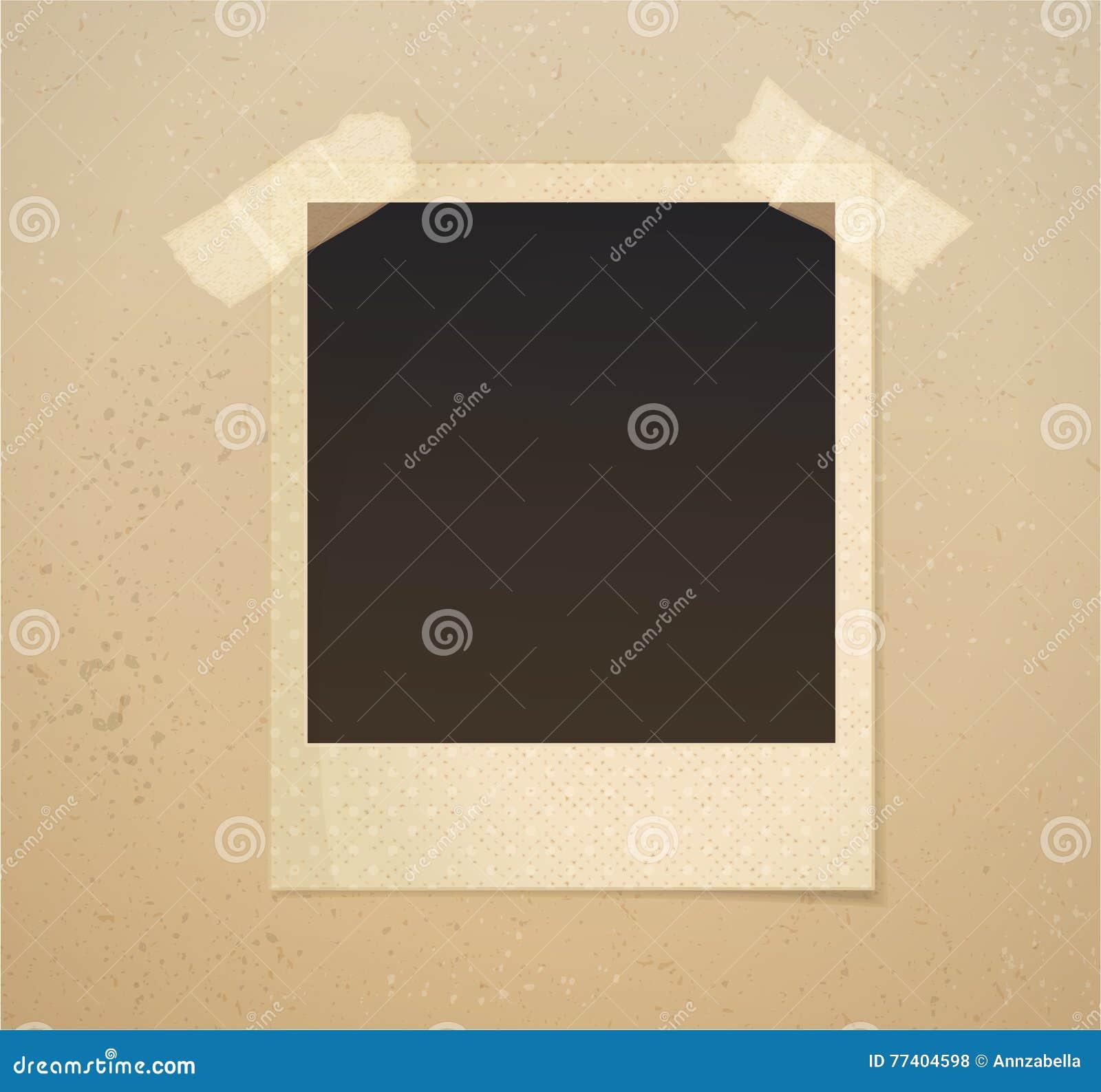 Photoframe sur le fond beige avec le ruban adhésif