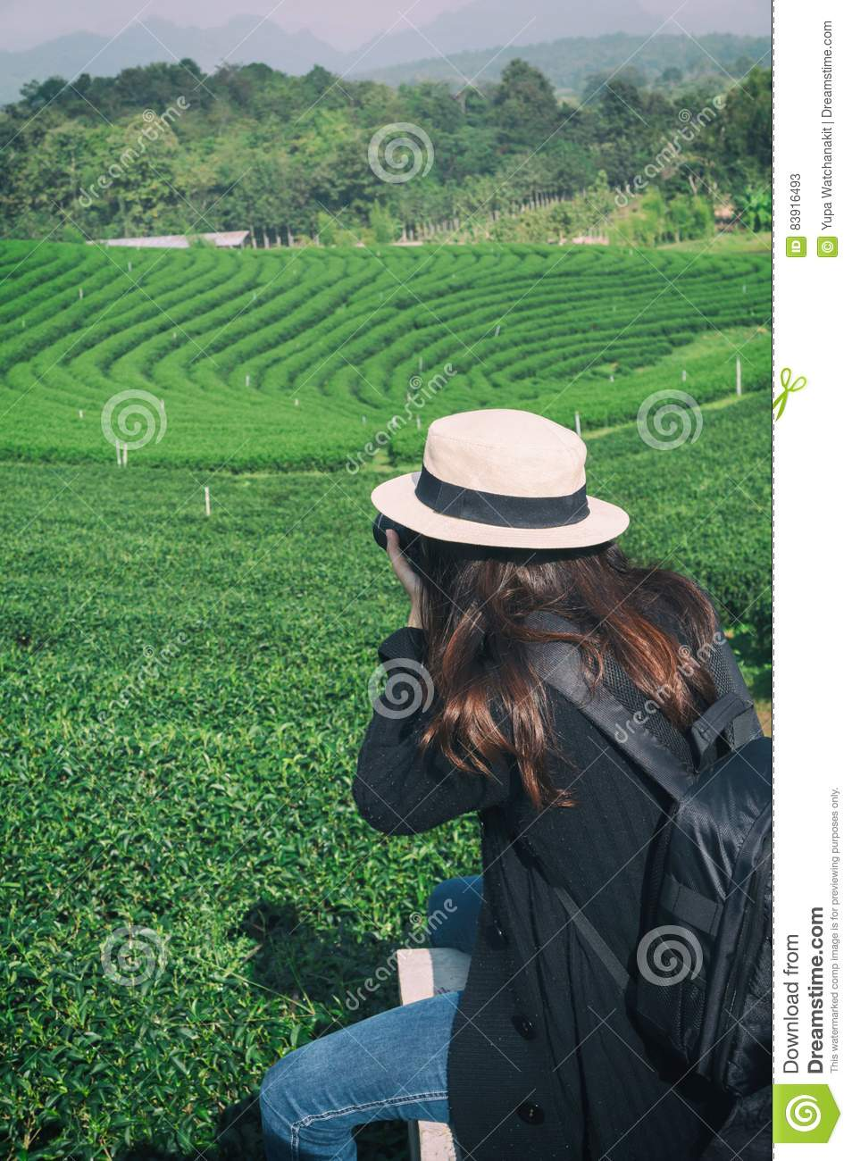Photograher holding DSLR Camera for shoot photo