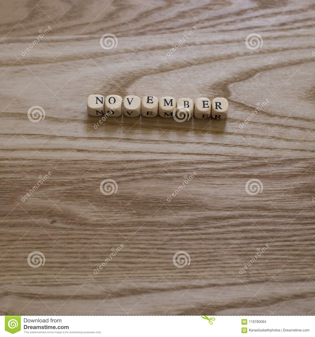 Wooden Letters Spelling November On A Wooden Background