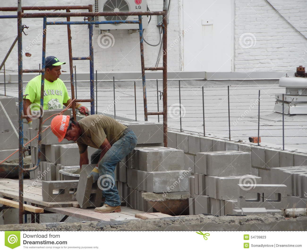 Photograph of Working Men Building Wall