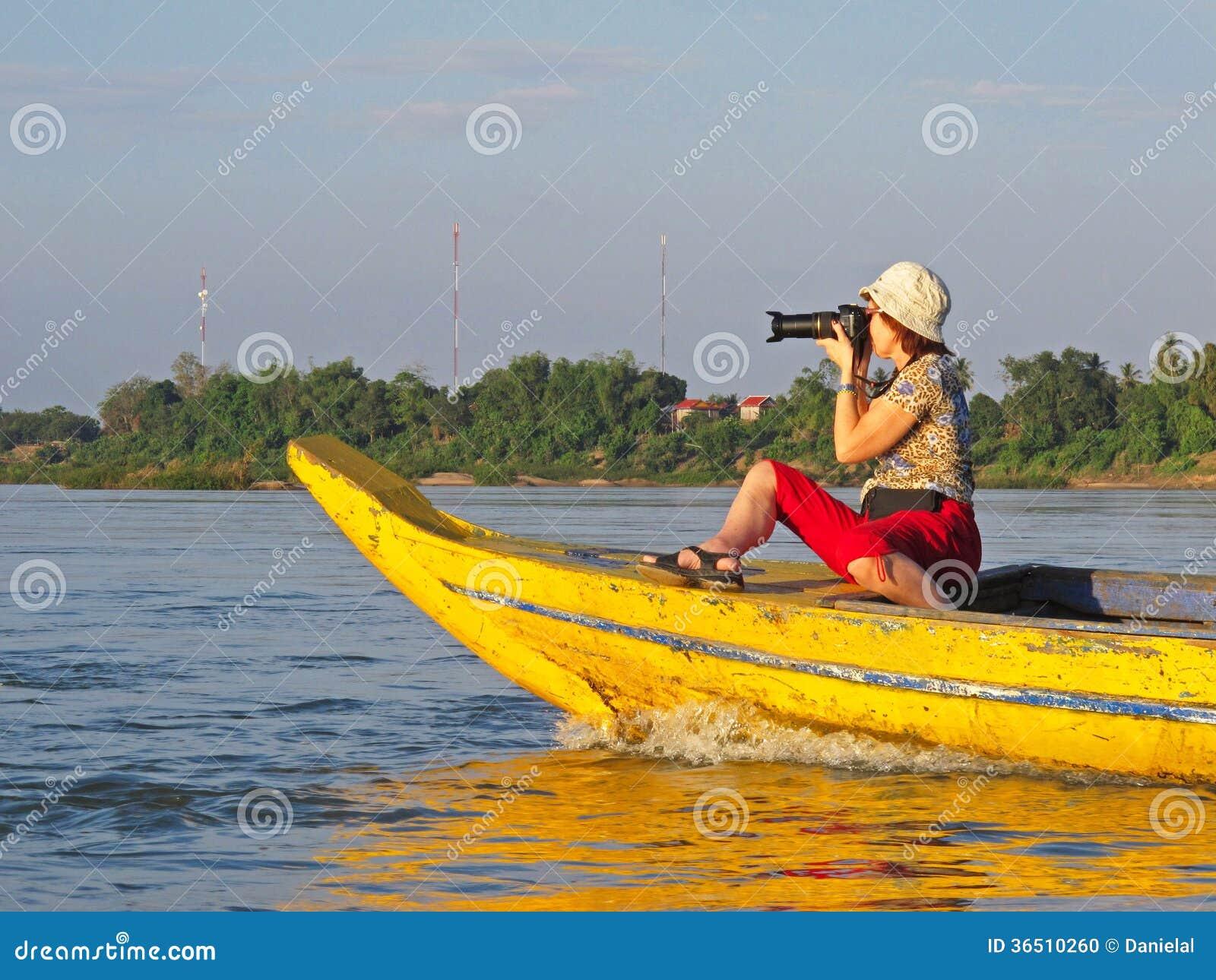 Photographe sur le bateau