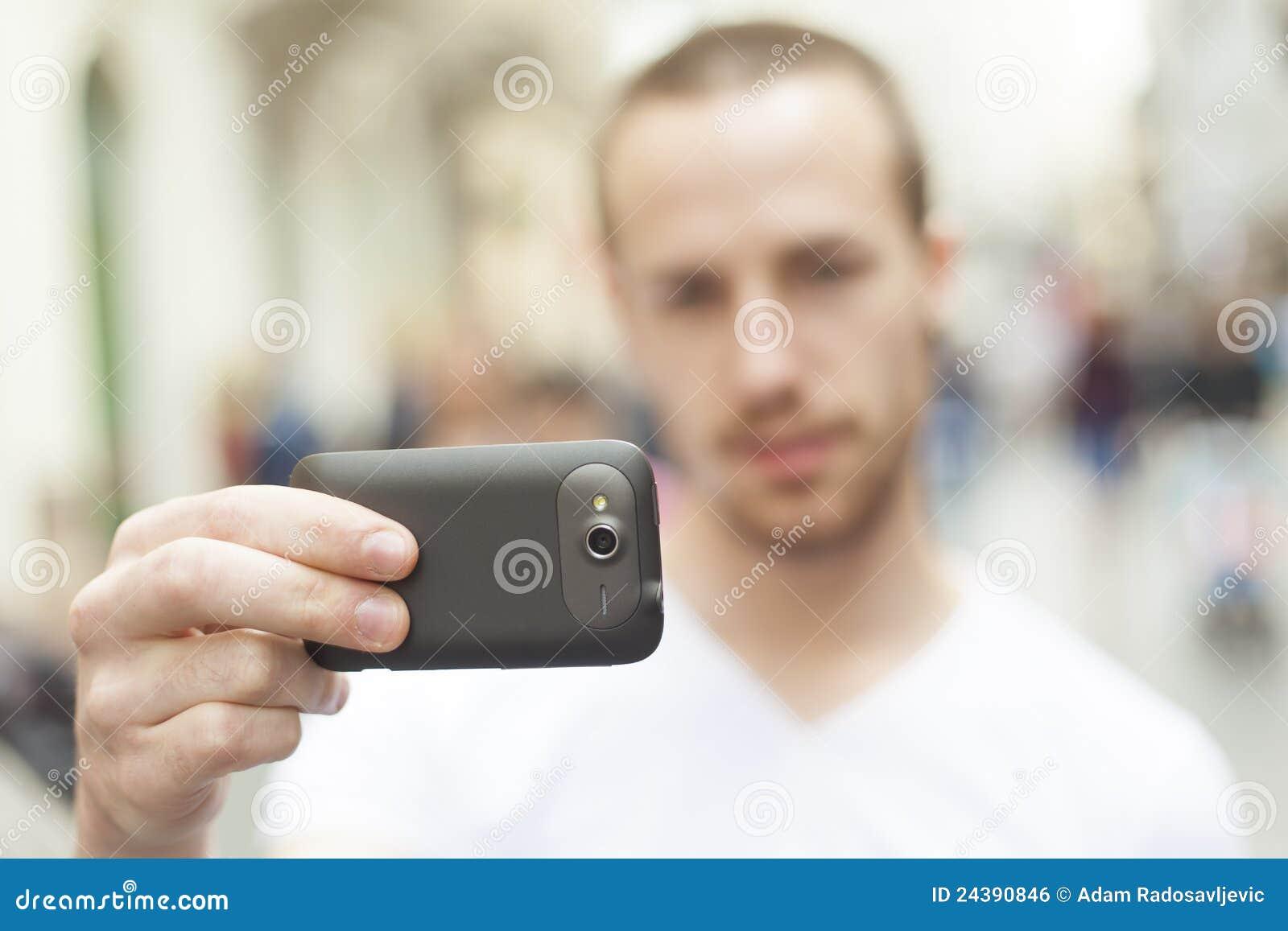 image libre de droits photographe urbain avec le tCAlCAphone mobila