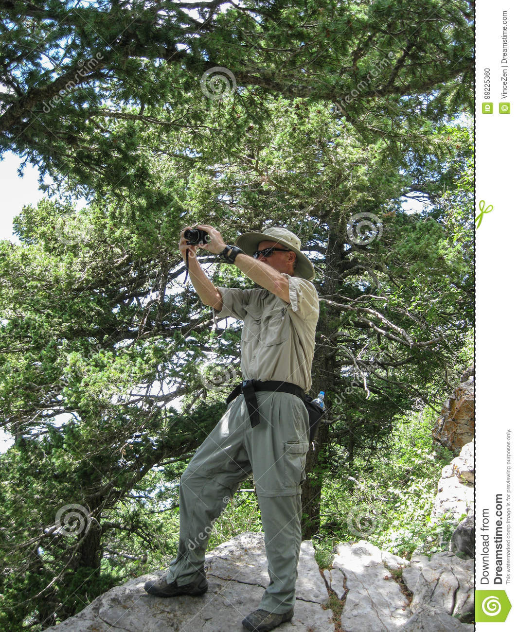Photographer capturing the landscape from a high overlook in the Sandia Mountains wilderness area.