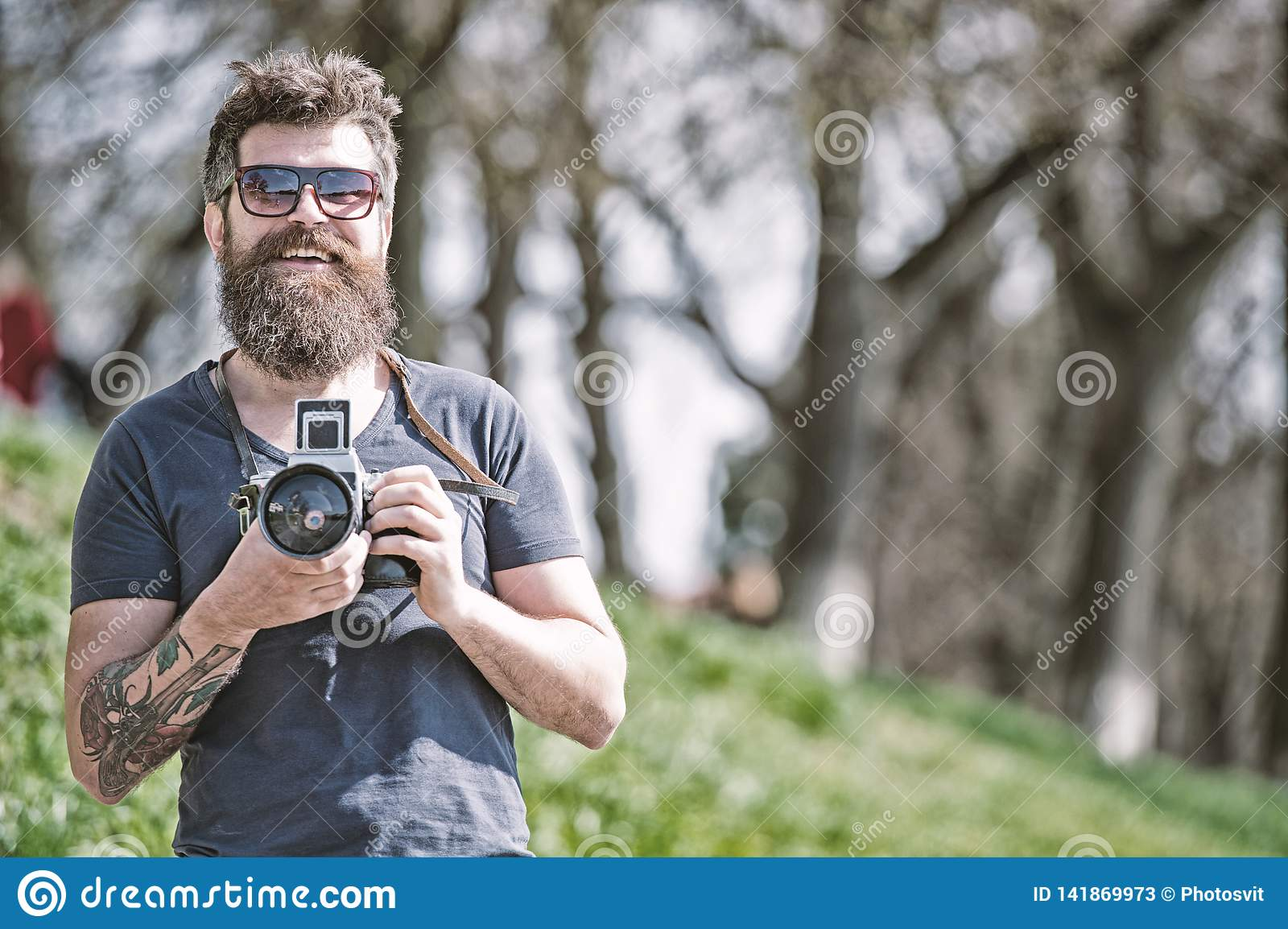 Photographer concept. Man bearded hipster photographer hold vintage camera. Photographer with beard and mustache amateur