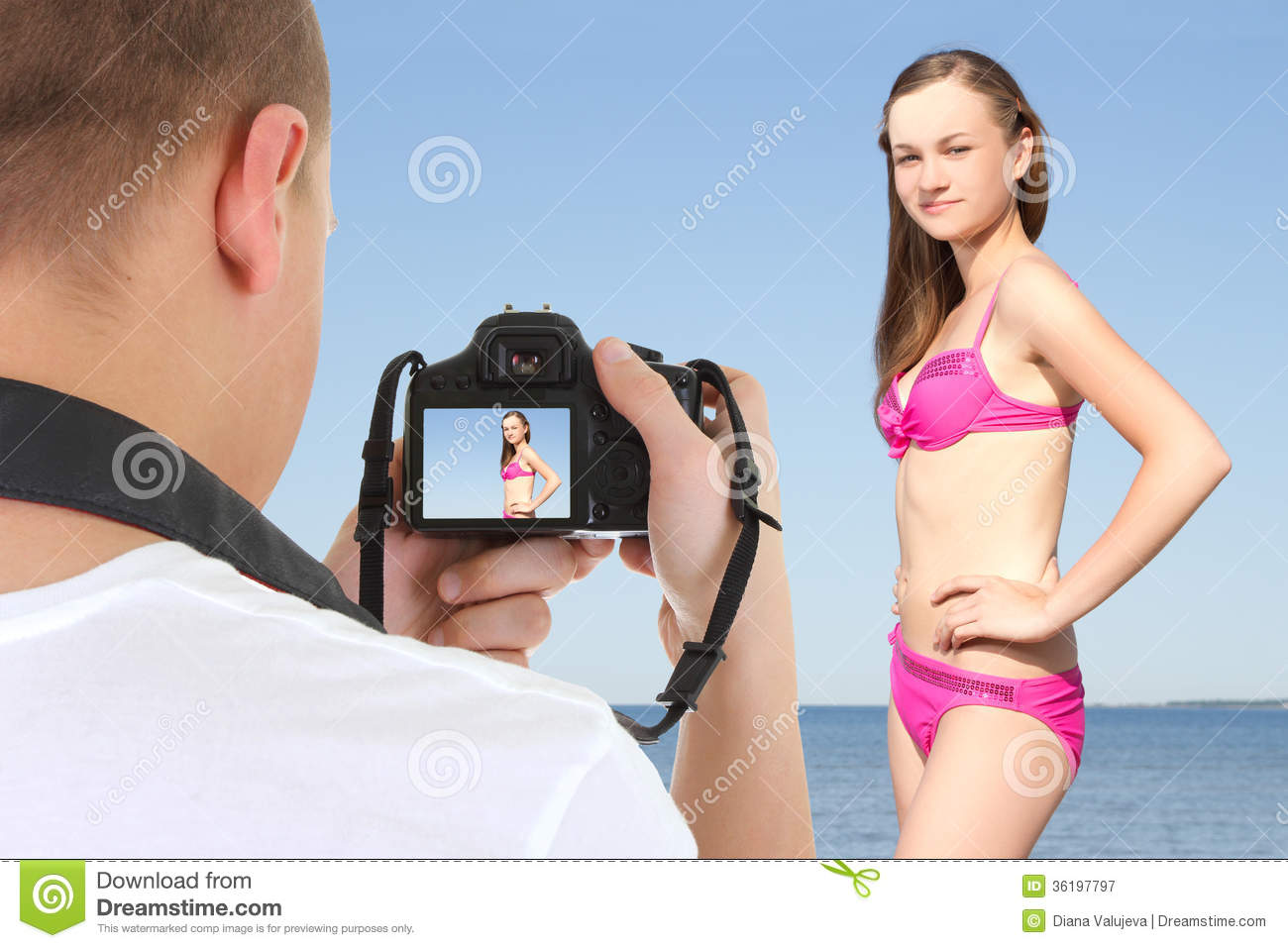 Photographer with dslr camera taking picture of young beautiful women ...