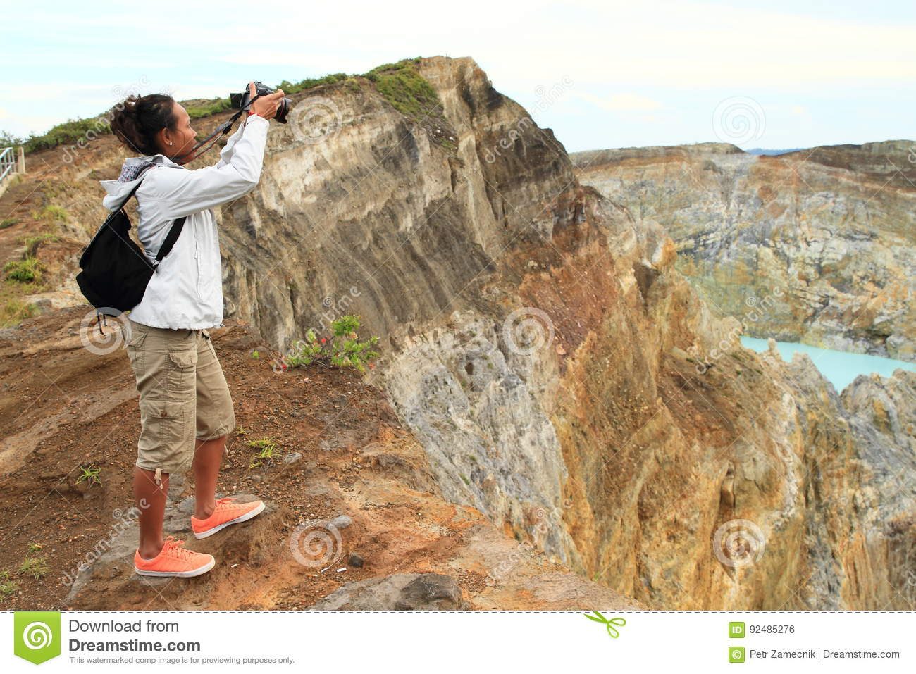 Photographer on Kelimutu taking photos of lakes Tap and Tin