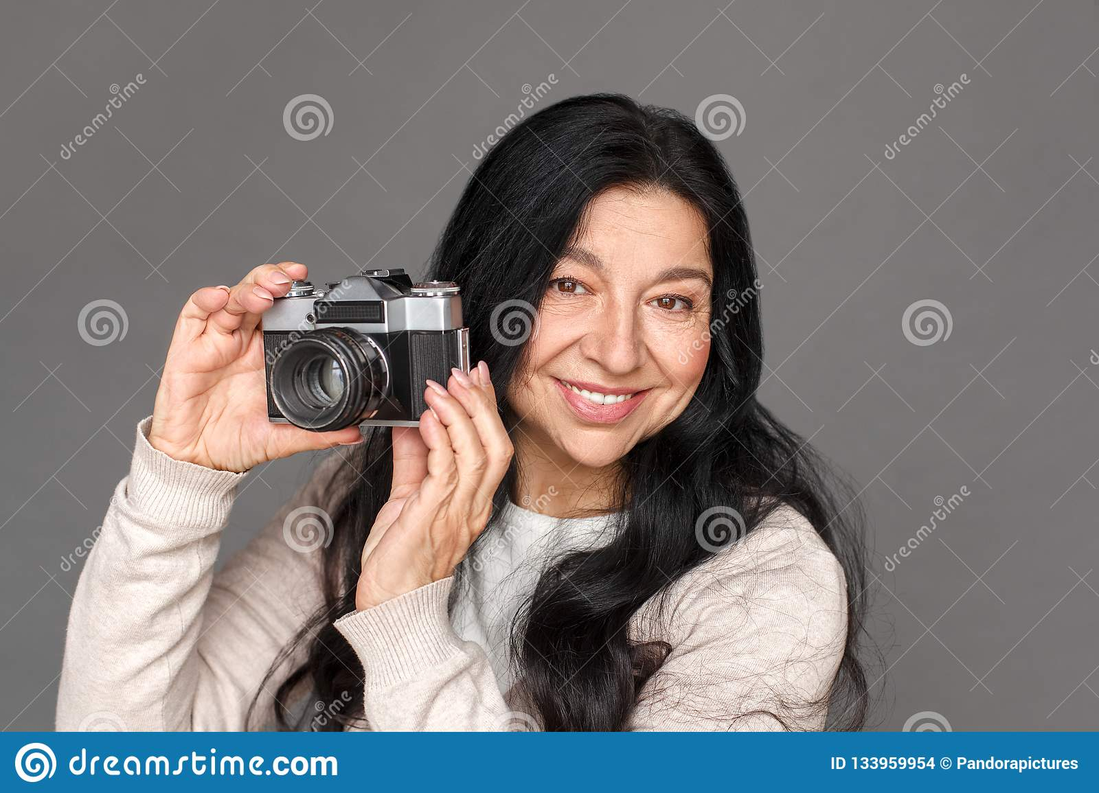 Photographer Mature Lady Standing On Grey Taking Pictures With