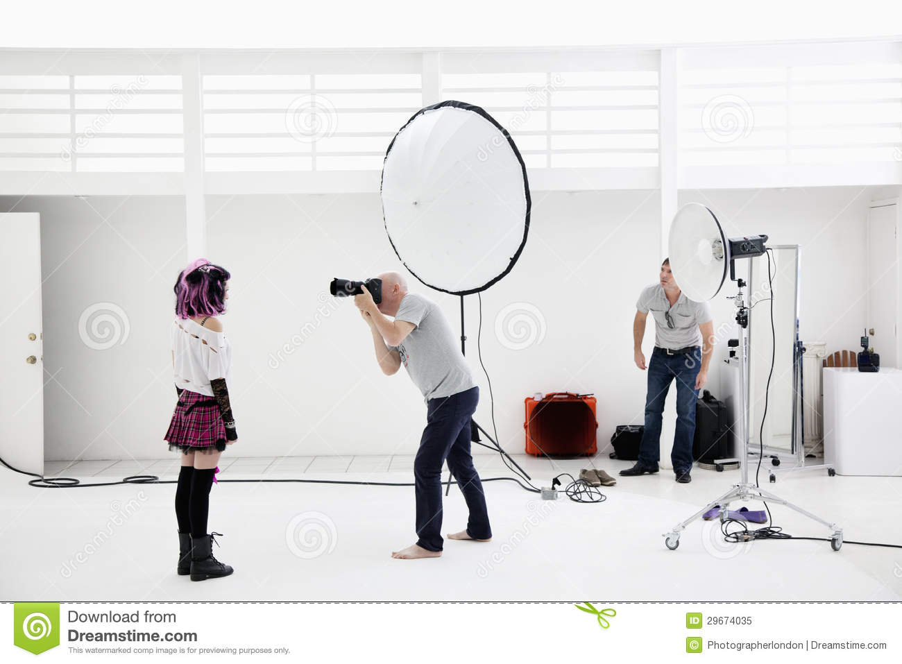 Photographer Shooting Fashion Model In Photo Shoot Royalty