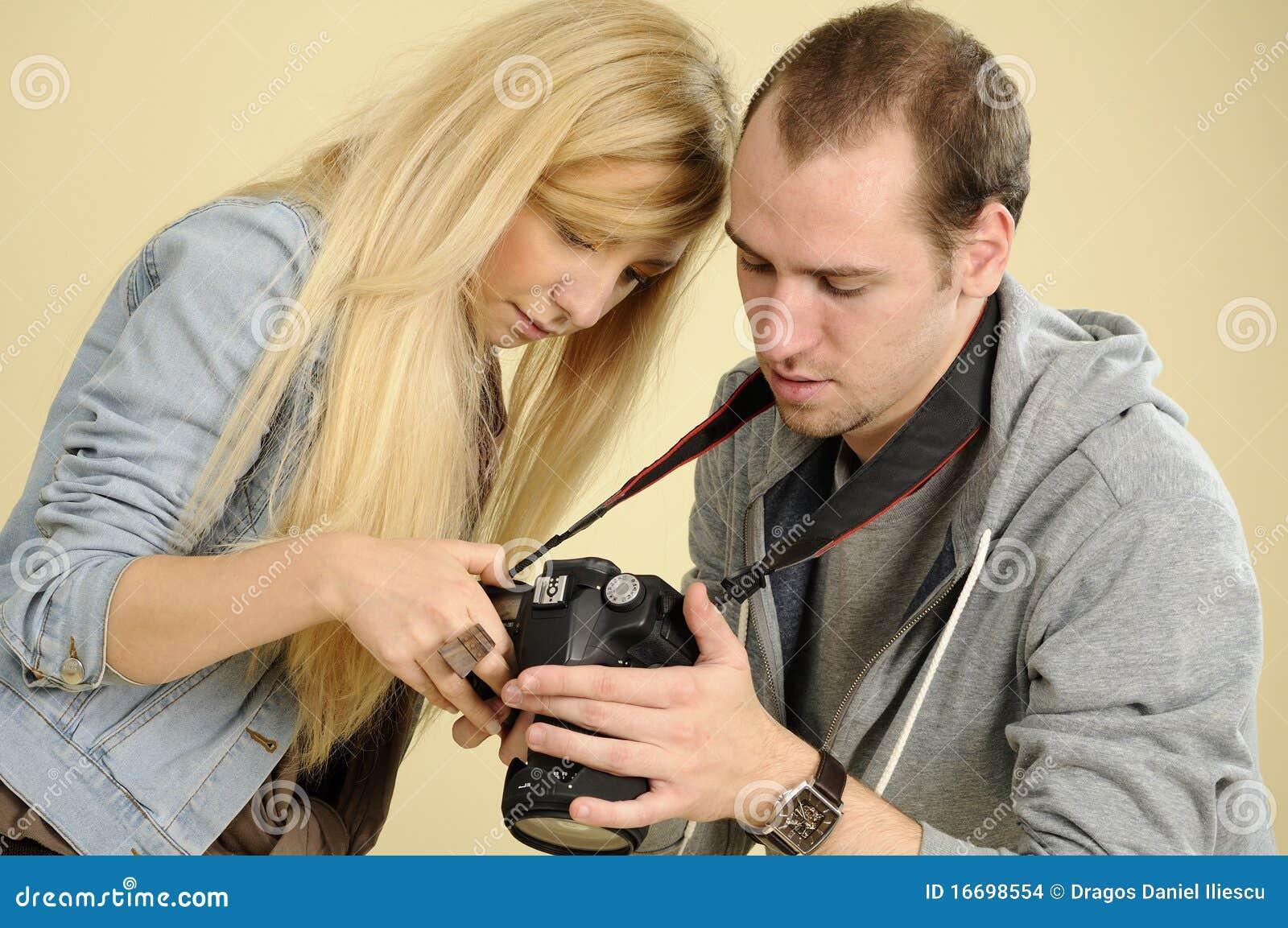 photographer studying on camera stock images image 16698554