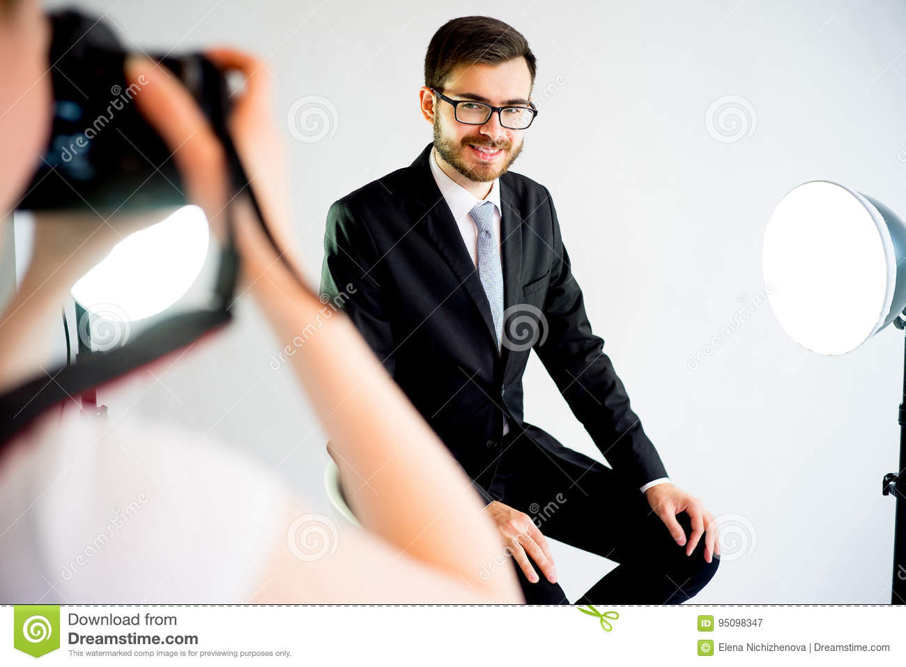 Download Photographer Taking Picture Of A Model In Studio Stock Image