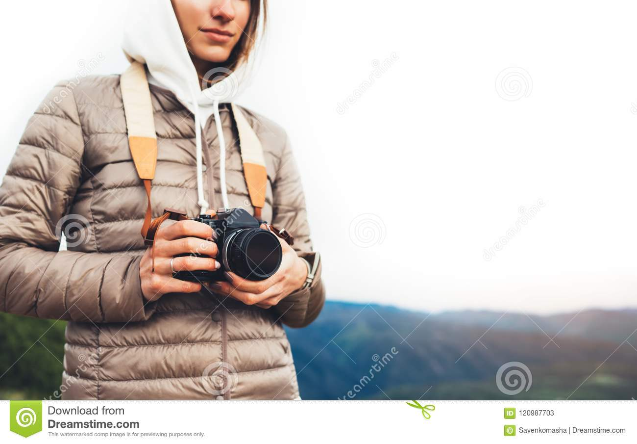 Photographer traveler on green mountain, tourist holding in hands digital photo camera closeup, hiker taking click photography, gi
