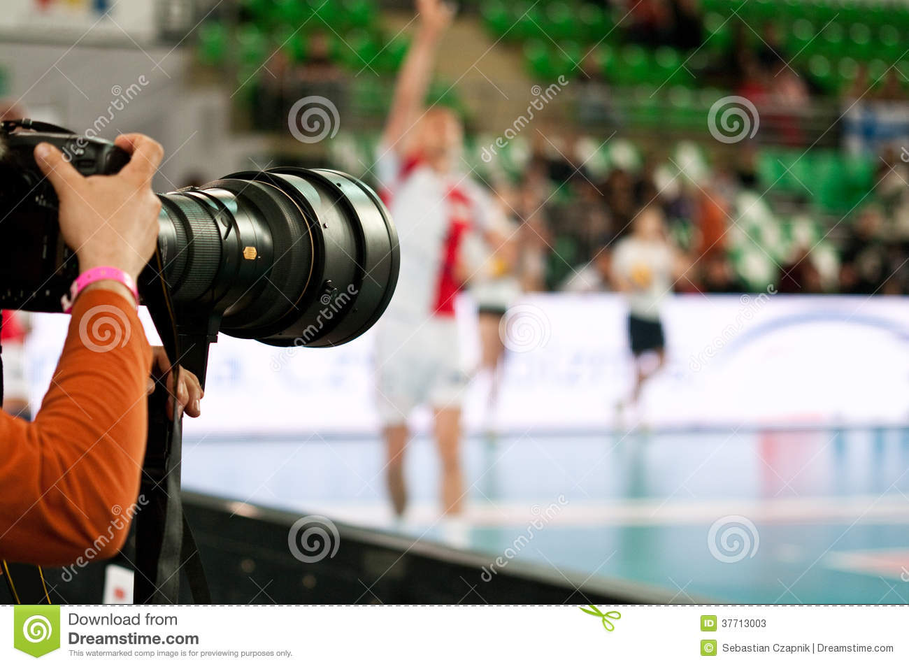Photographer at volleyball match