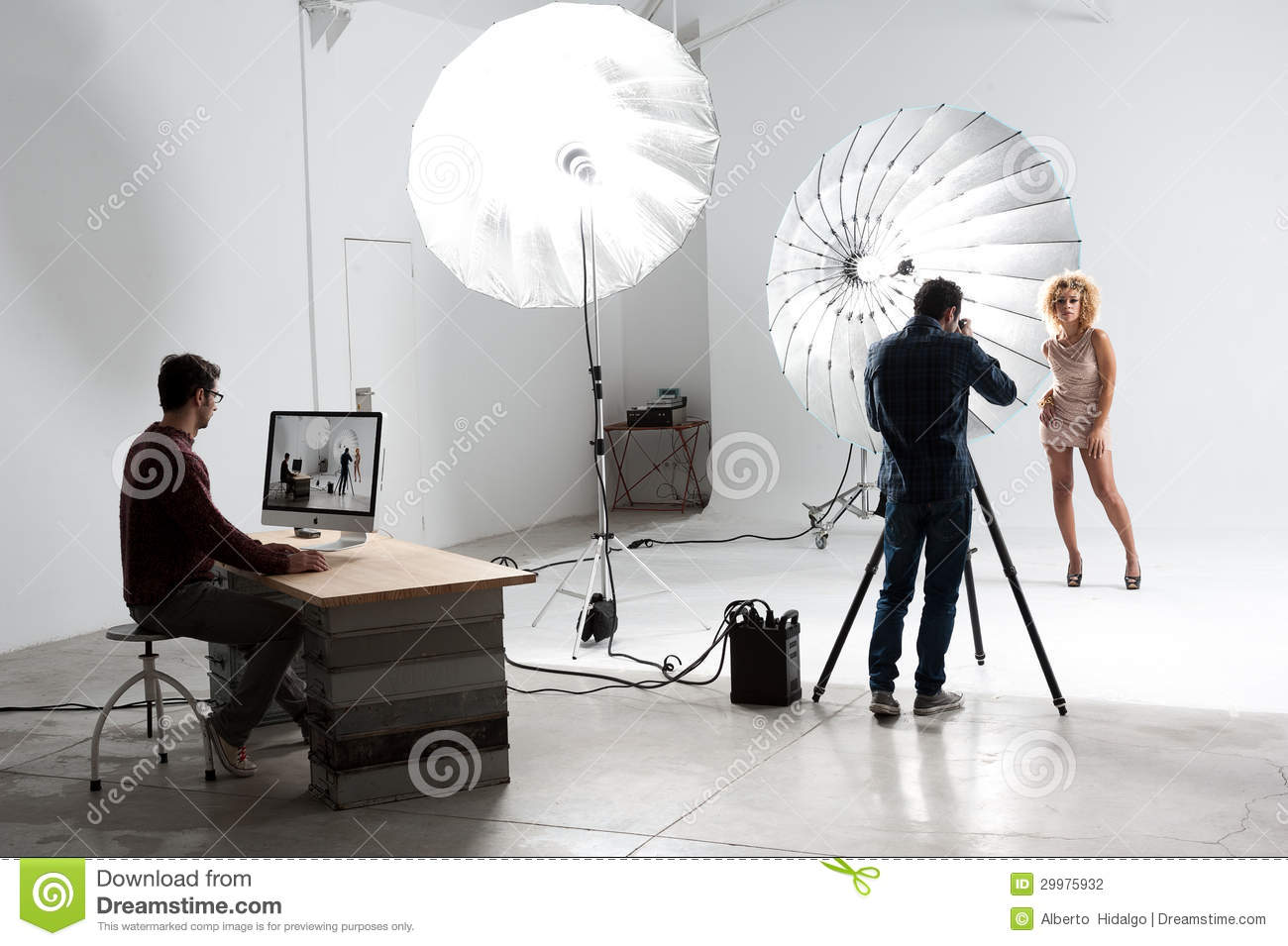 Photographer working with a Cute Model in a Professional Studio