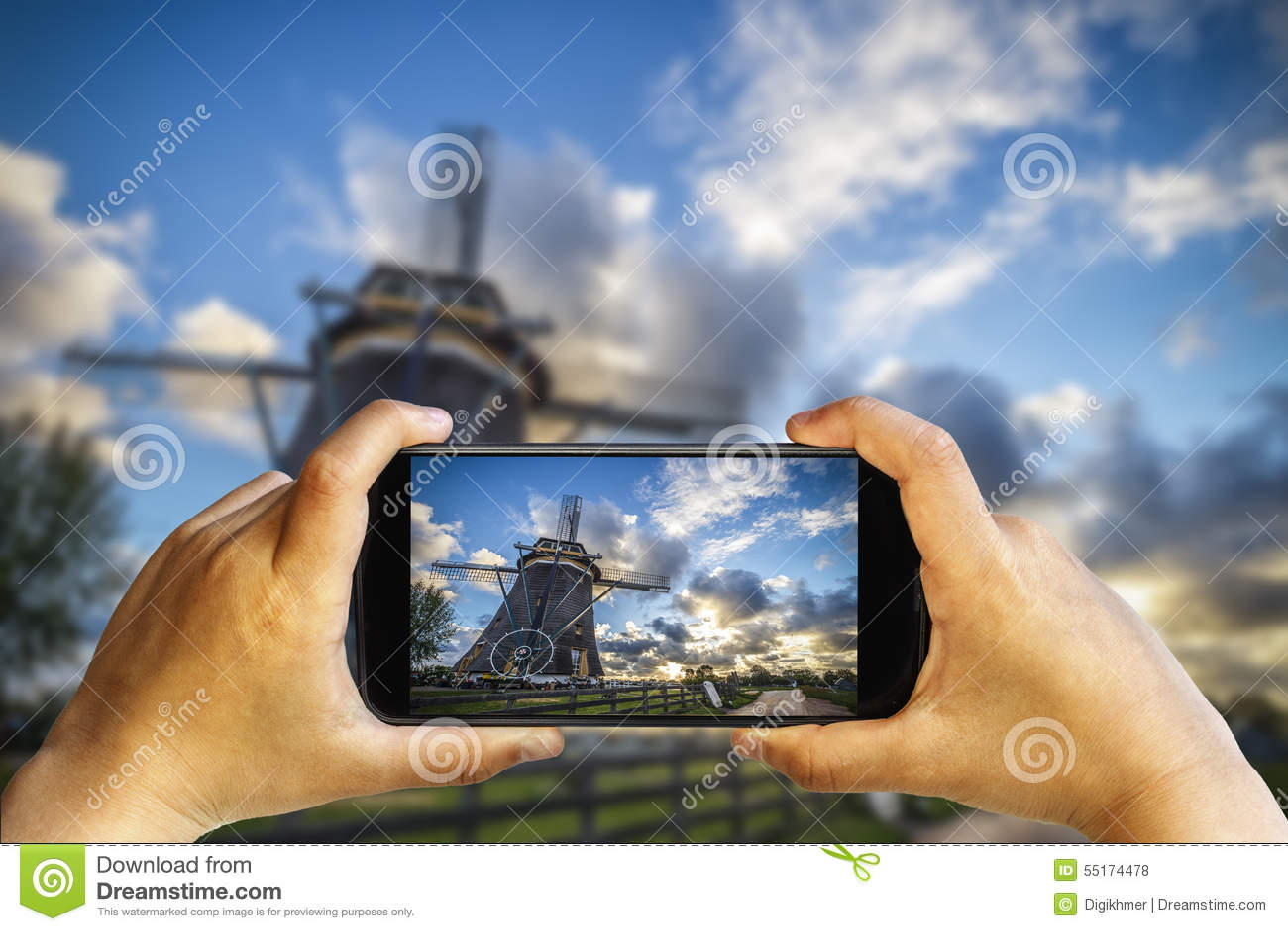 Photographie de téléphone de coucher du soleil de moulin à vent