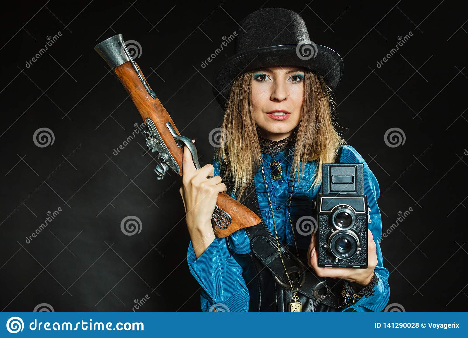 Steampunk with old retro camera and pistol