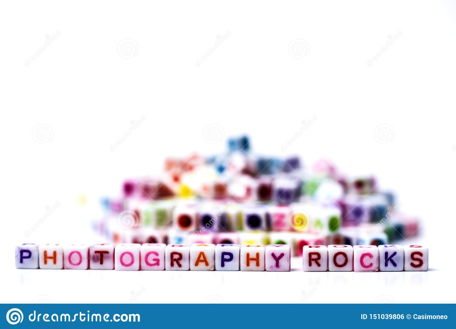 Photography Rocks - conceptual approach using plastic letter tiles forming writing the two words Photography and Rocks