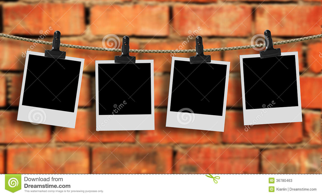 Photos hanging on a clothes line stock photos image for Four blank walls