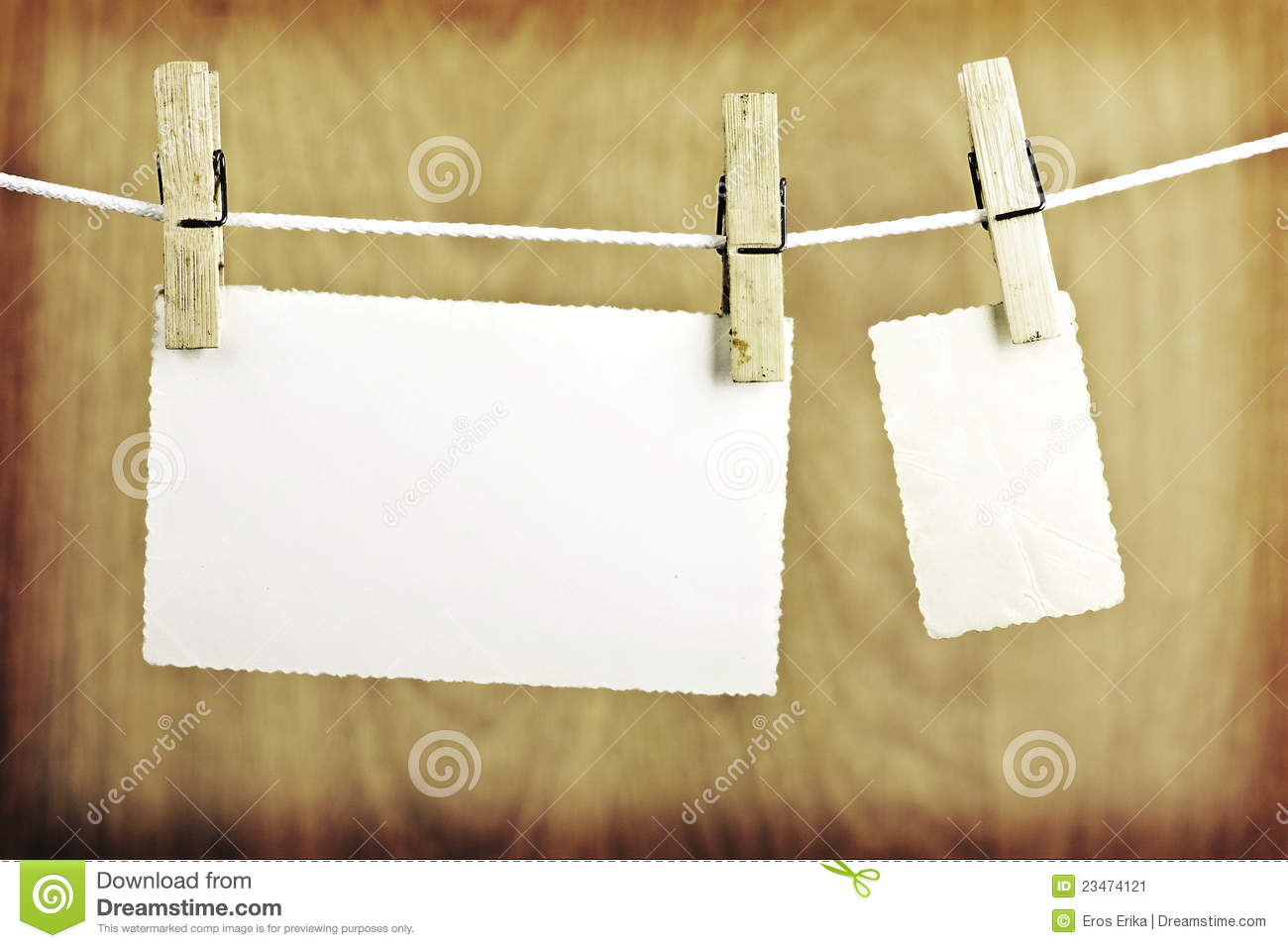 photos hanging on a colthesline stock image image 23474121