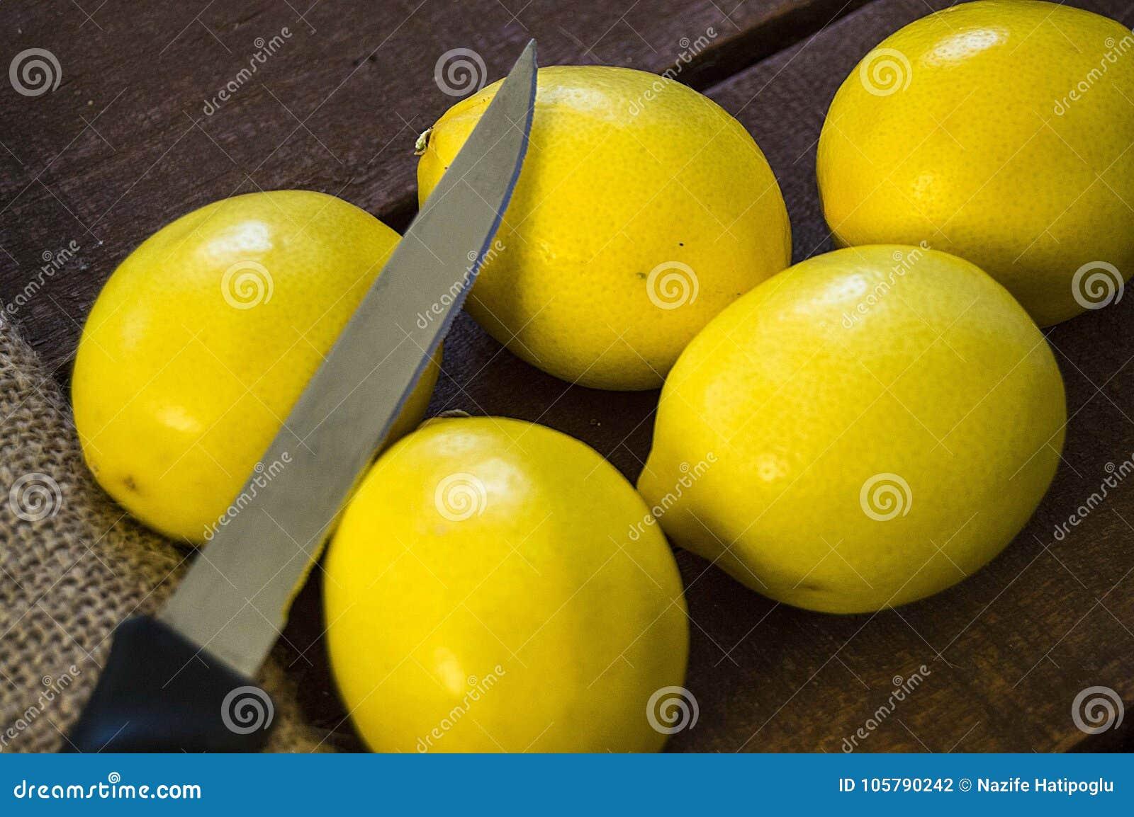PPhotos Of Lemon With Knife On Wooden Floors, Hand-cut ...