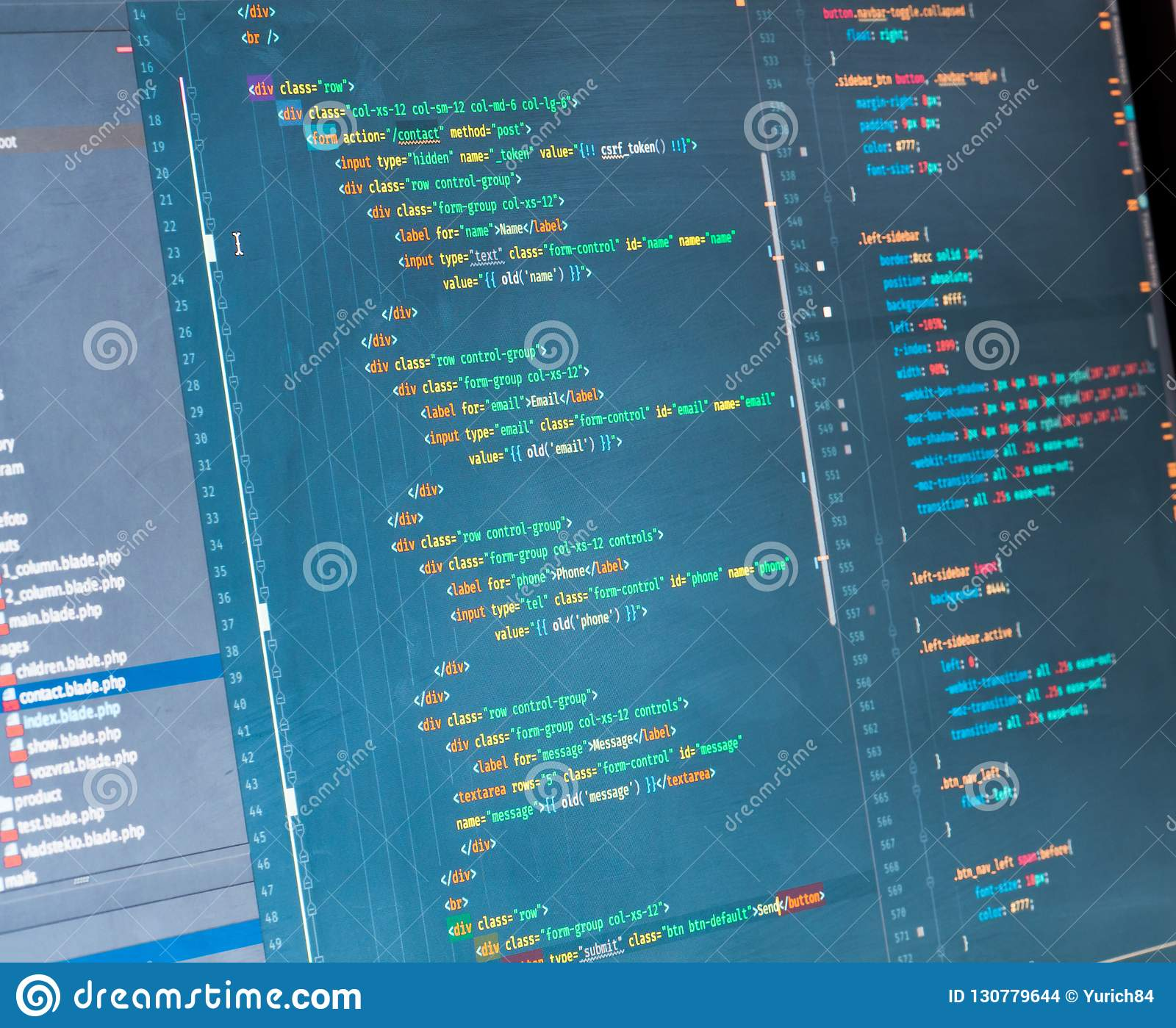 PHP code on the screen, close up. Orange, green and yellow coding on blue background