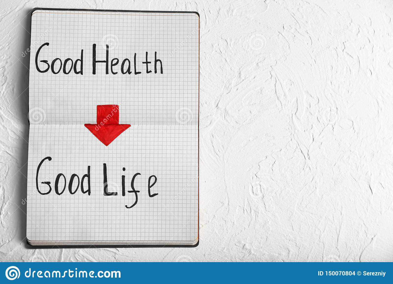 Phrase  Good health - good life   written in notebook on white background