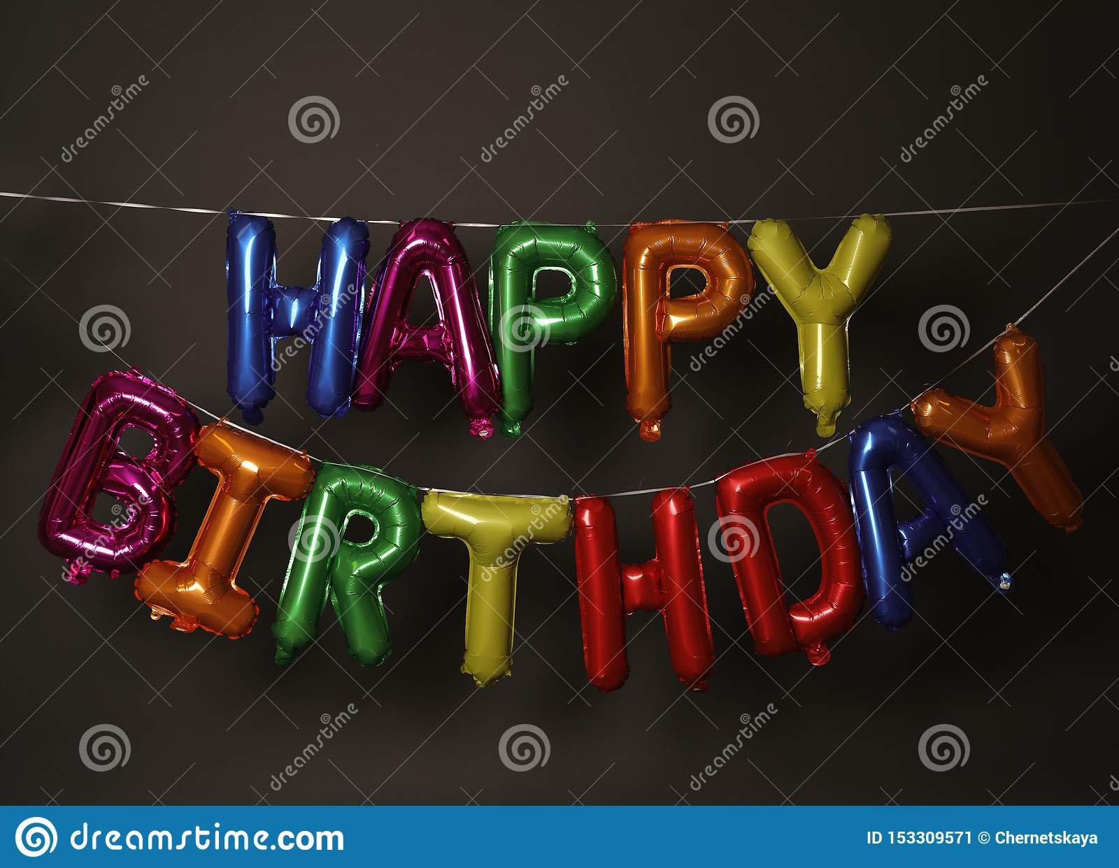 Phrase HAPPY BIRTHDAY made of colorful balloon letters