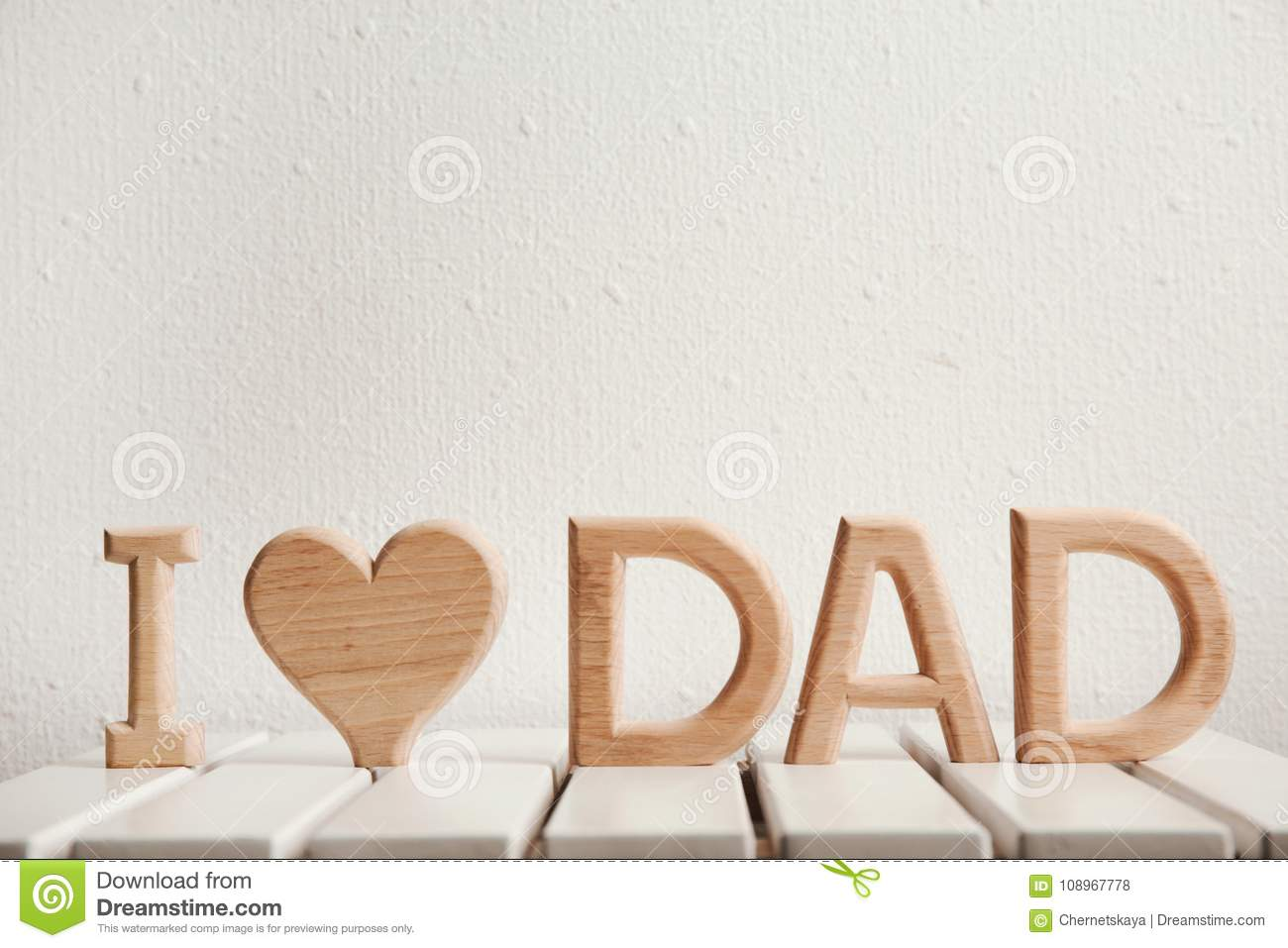 Phrase I Love Dad Made Of Wooden Letters As Greeting For Fathers