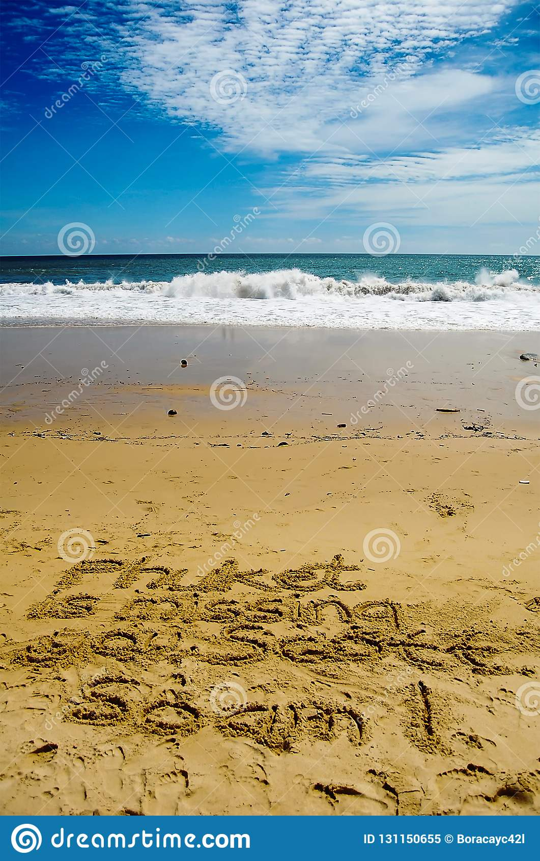 Phuket Is Missing You inscribed on beach sand