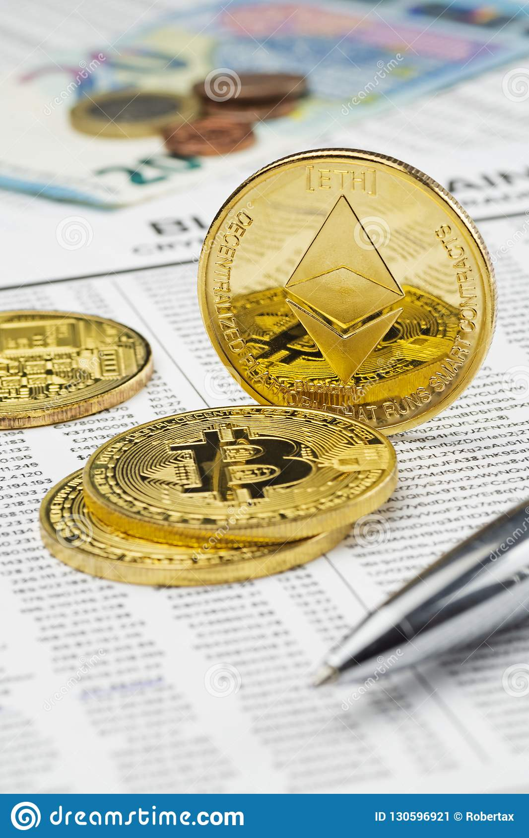 Physical Bitcoin And Ethereum Coins On Mockup Blockchain