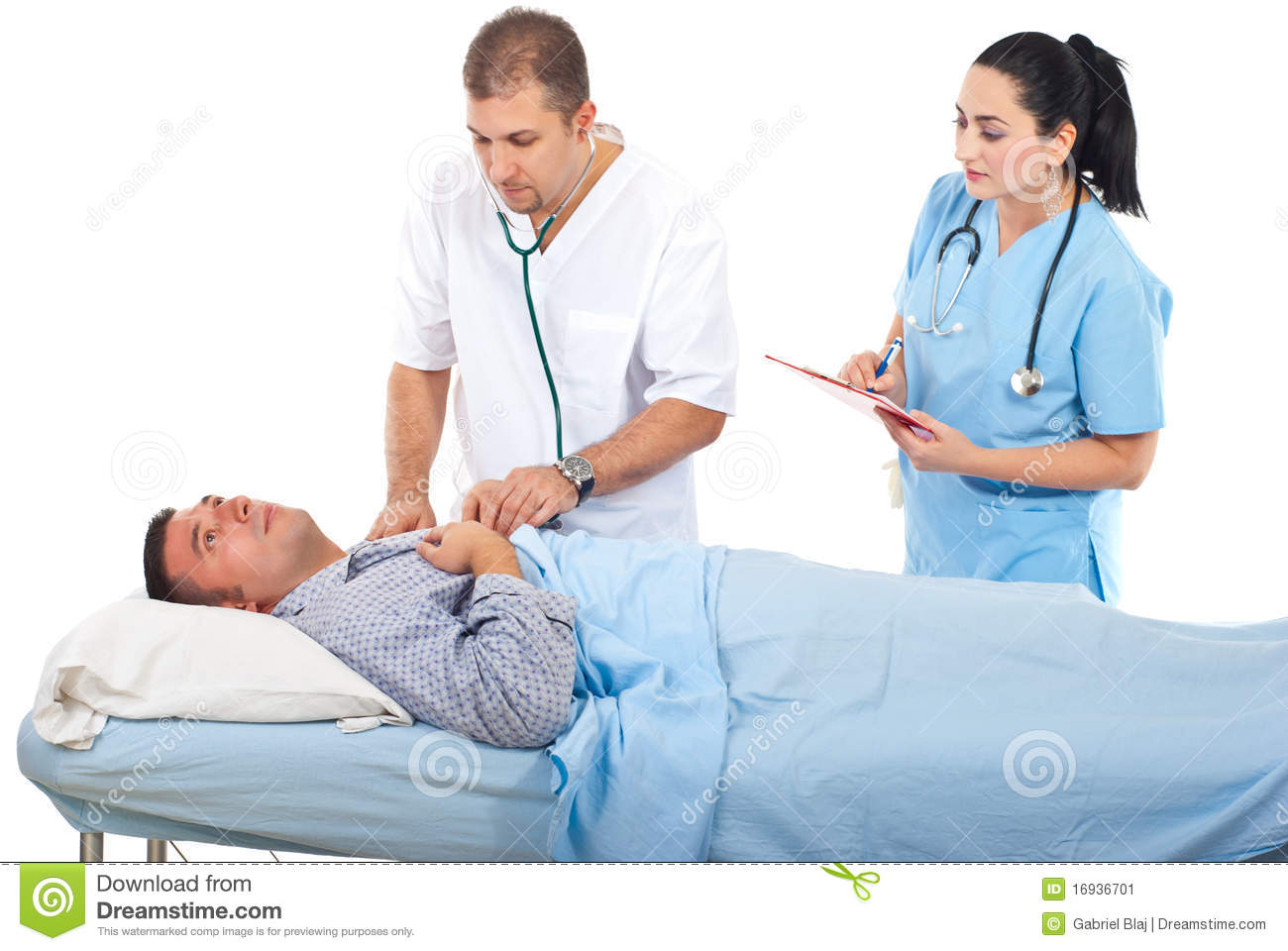Physician man assessing sick patient in hospital and a nurse assisting ...