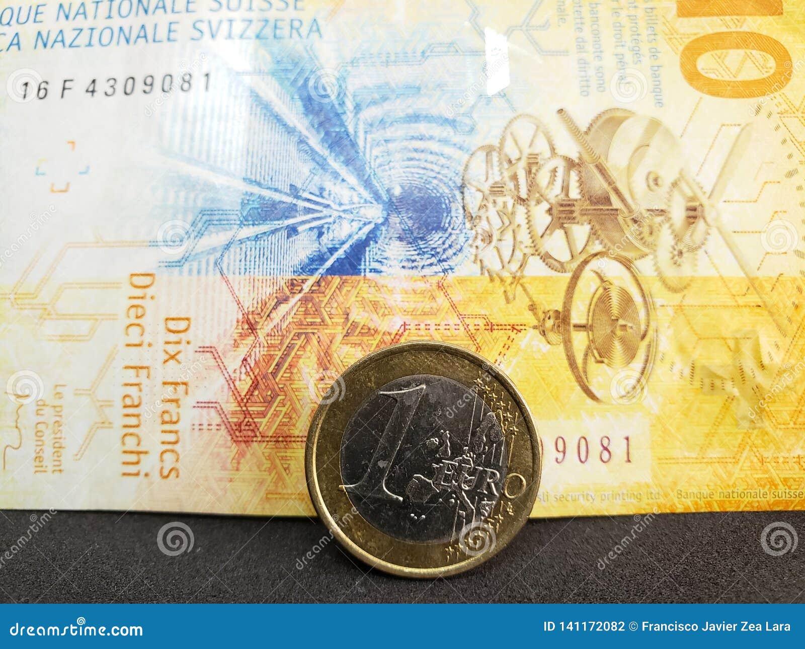 Piece De Monnaie D Un Euro Et Billet De Banque Suisse De Dix