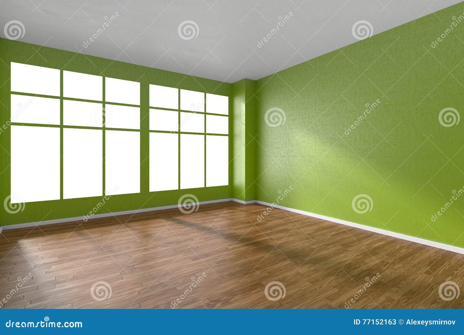 Pièce vide avec le plancher de parquet, les murs texturisés verts et le grand vent