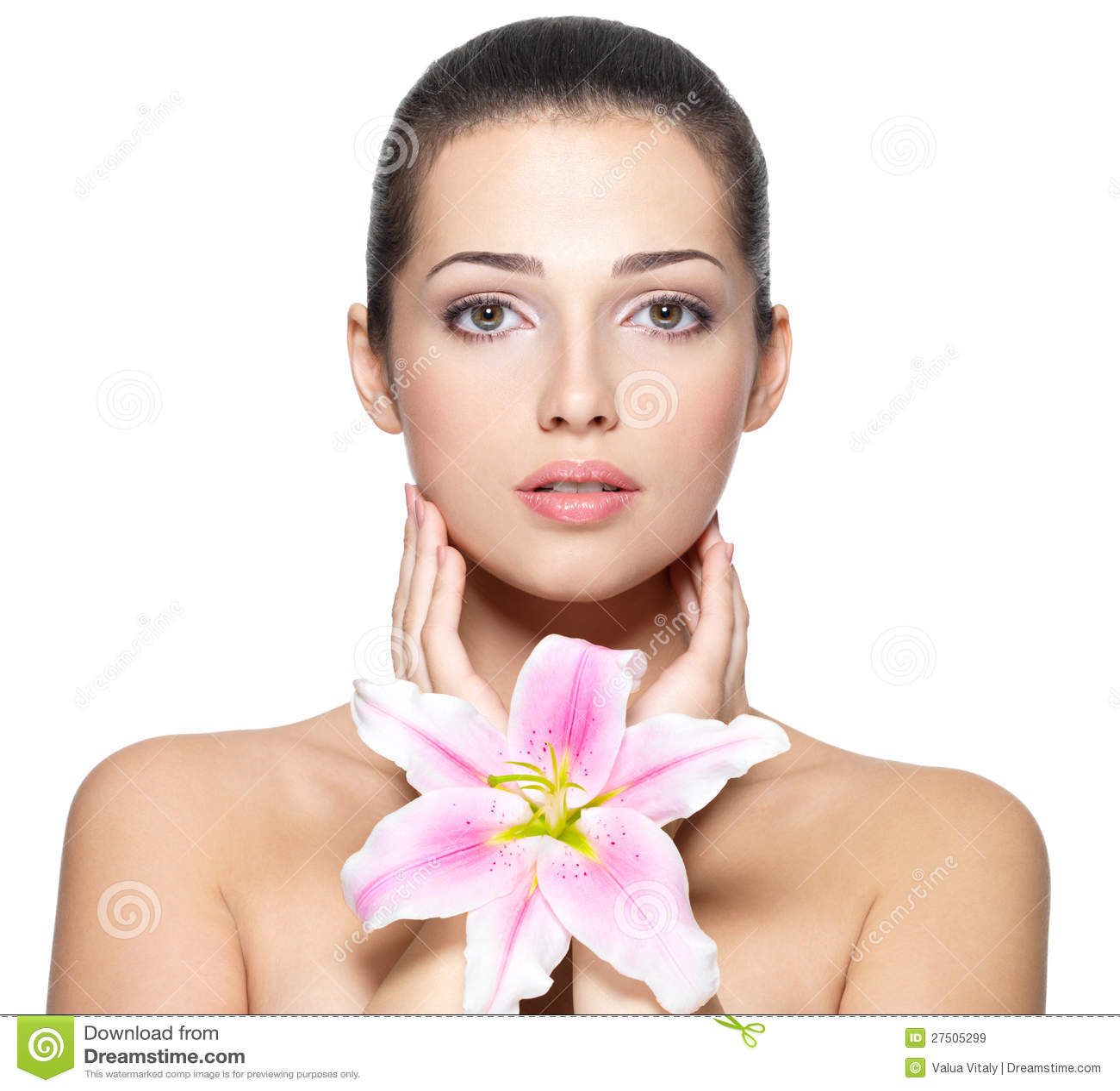 Piękna twarz młoda kobieta z kwiatem