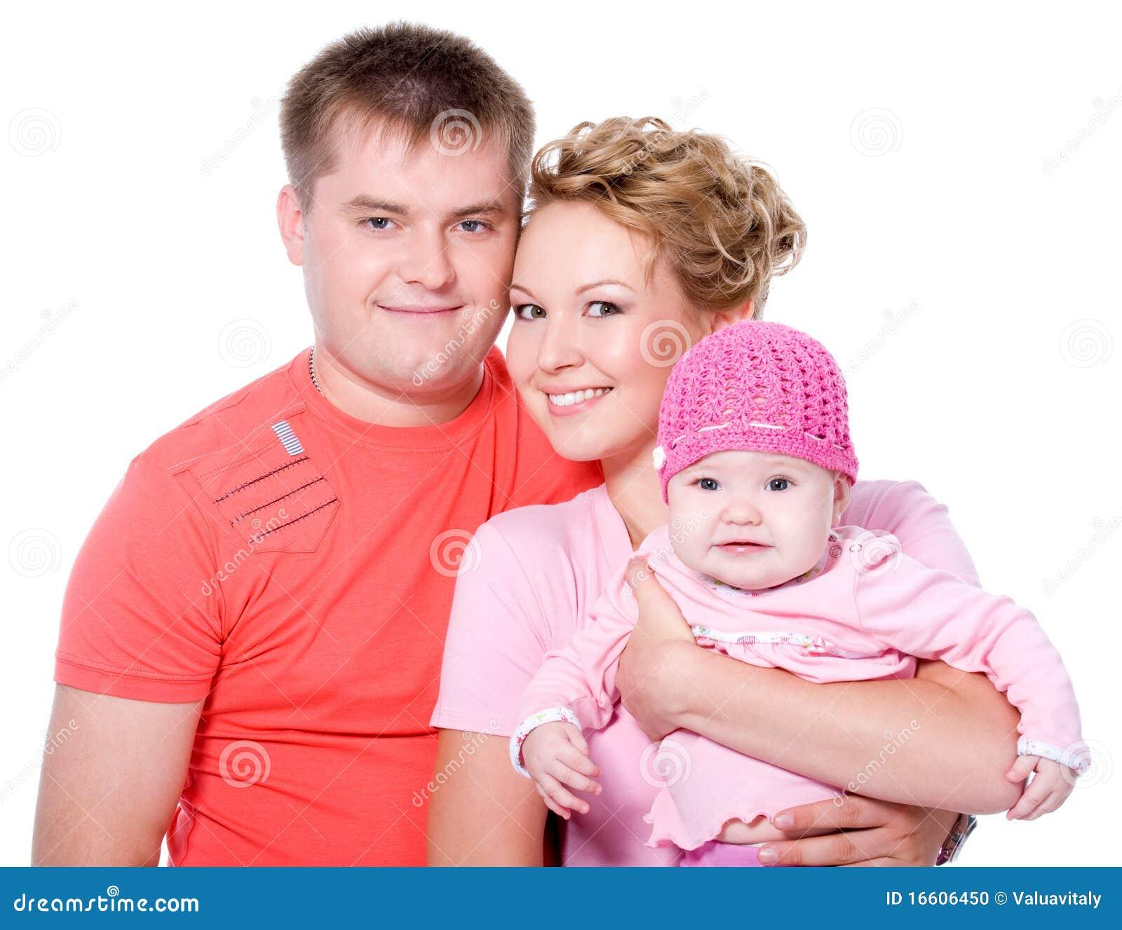 Pięknej pary szczęśliwi uśmiechnięci potomstwa