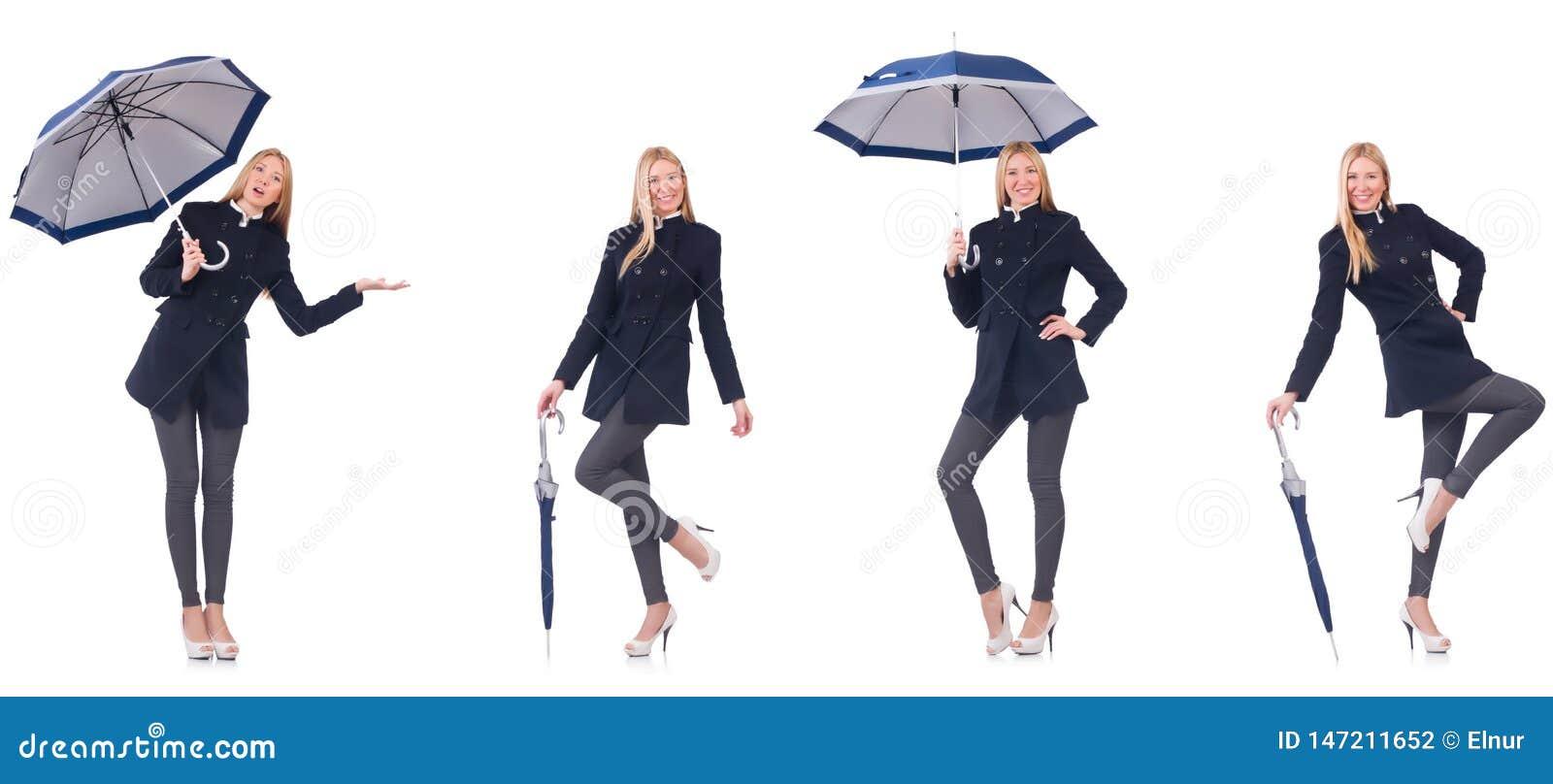 Pi?kna kobieta w czarnym ?akiecie z parasolem