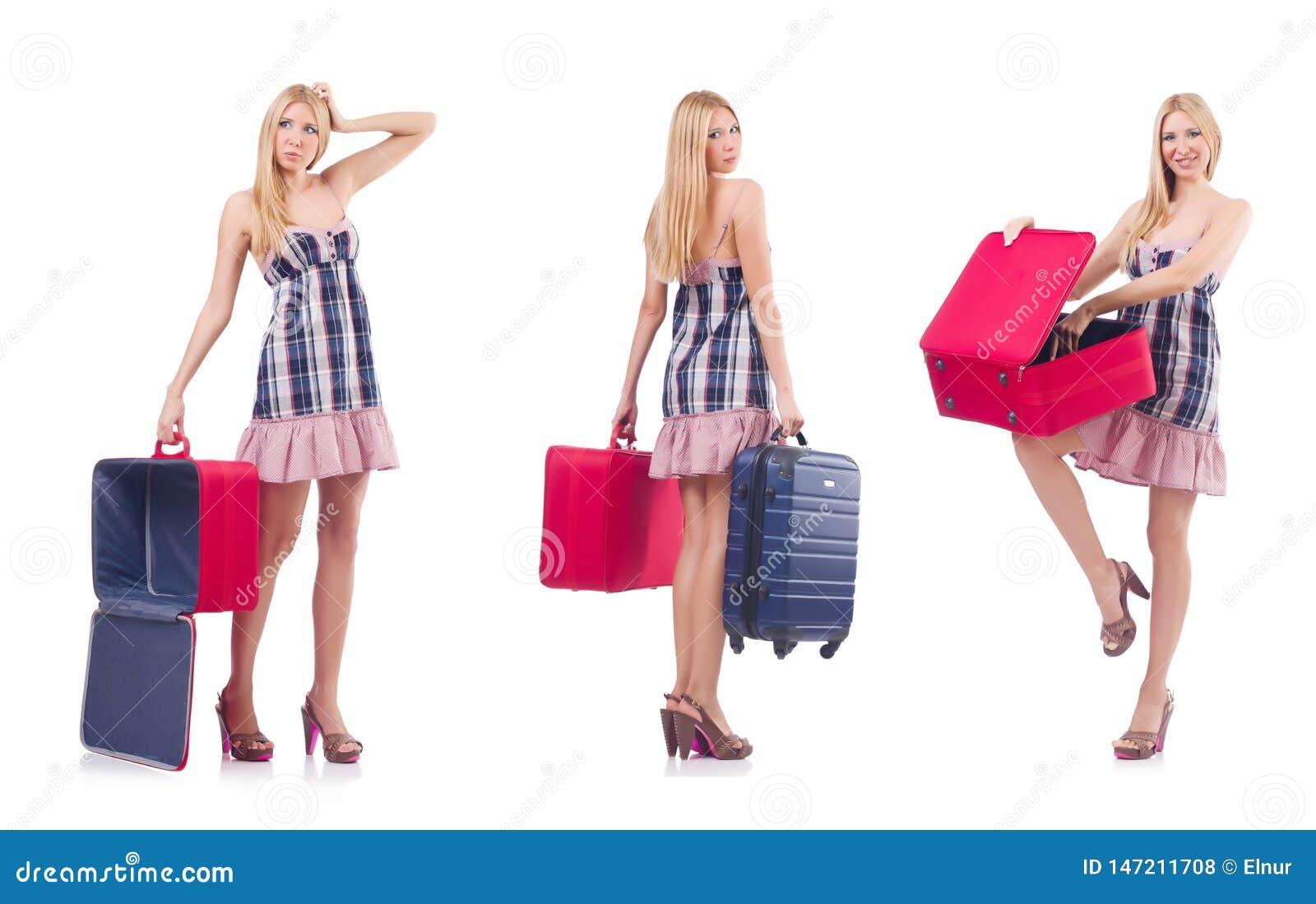 Pi?kna kobieta z walizk? odizolowywaj?c? na bielu